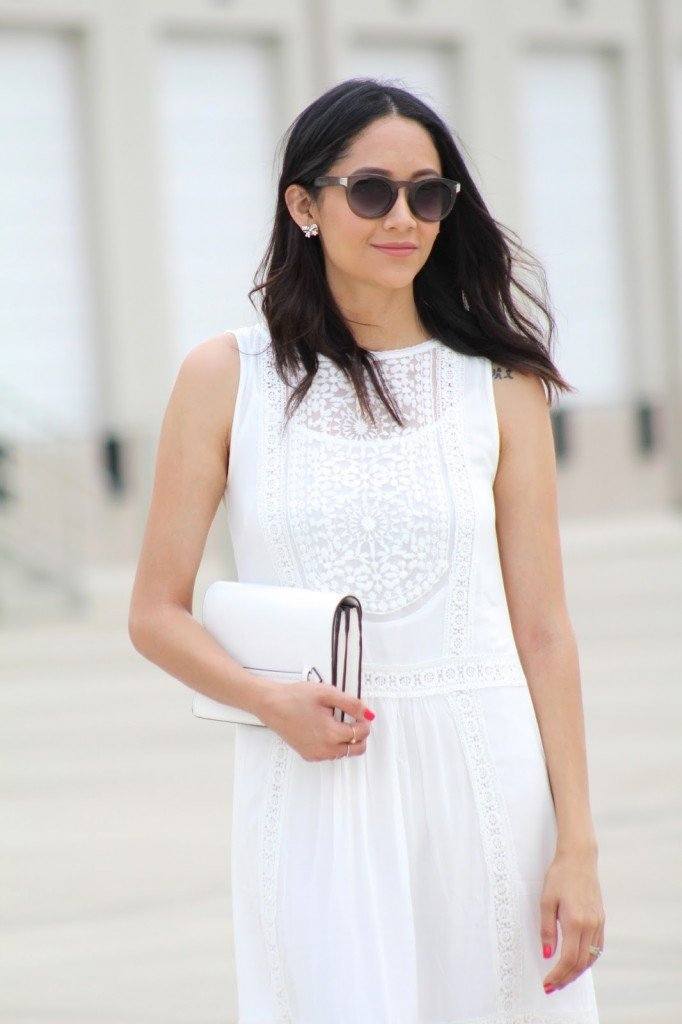 little white lace dress and white clutch