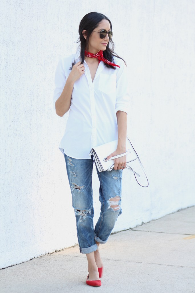 Style blogger Daily Craving wears boyfriends jeans, a white button up shirt, red bandana and red flats