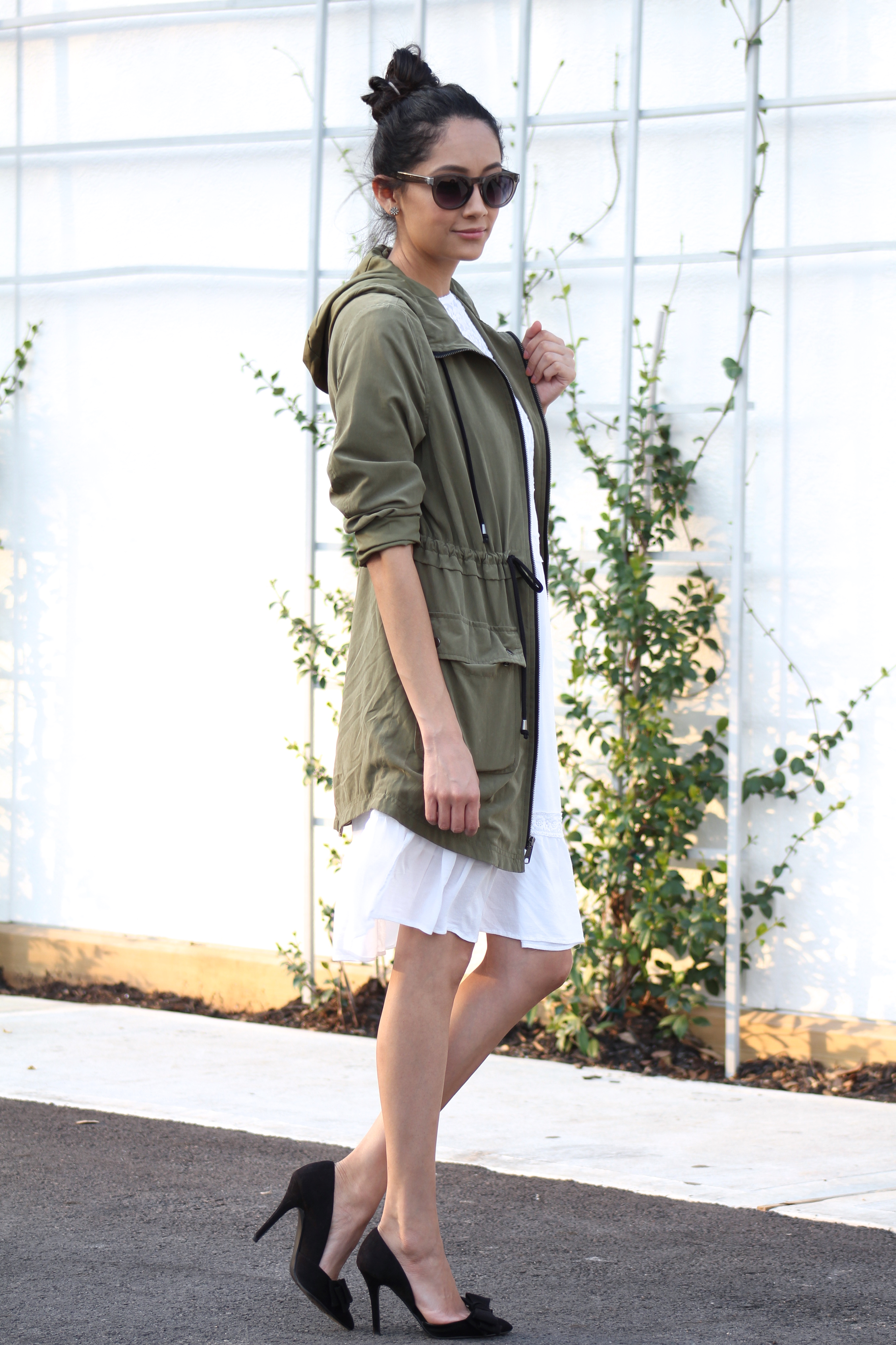 army green parka with a lace dress