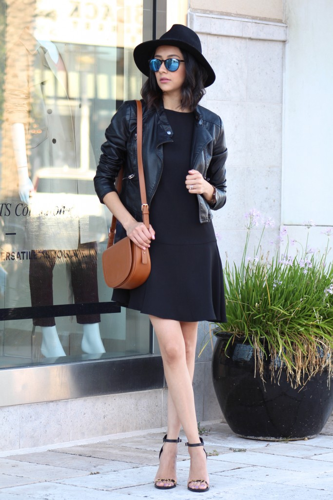 All black outfit with tan bag