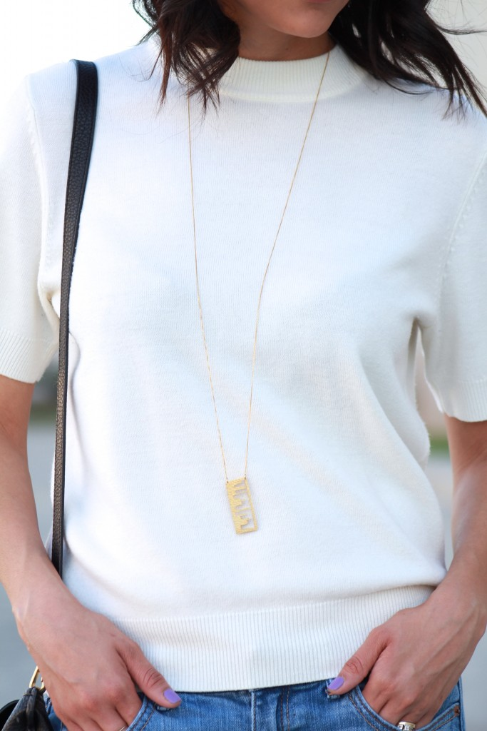 short sleeve sweater and pendant necklace