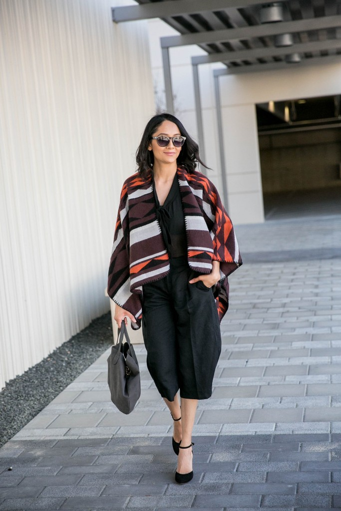 Daily Craving in a chic fall outfit with a printed poncho and black culottes