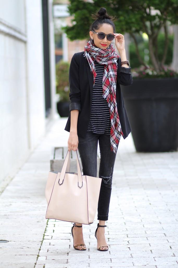 A striped shirt with a plaid scarf