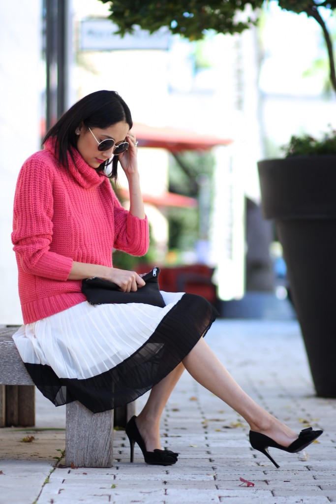 dressing down a pleated skirt with a turtleneck sweater
