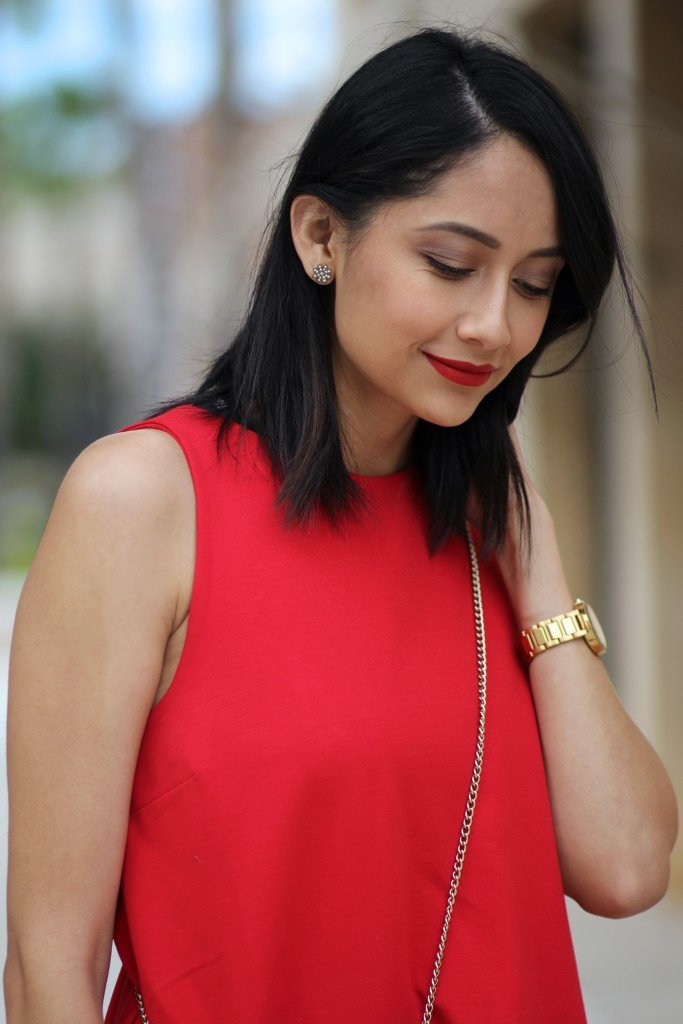 Lilly Beltran of Daily Craving in a red dress and red lipstick