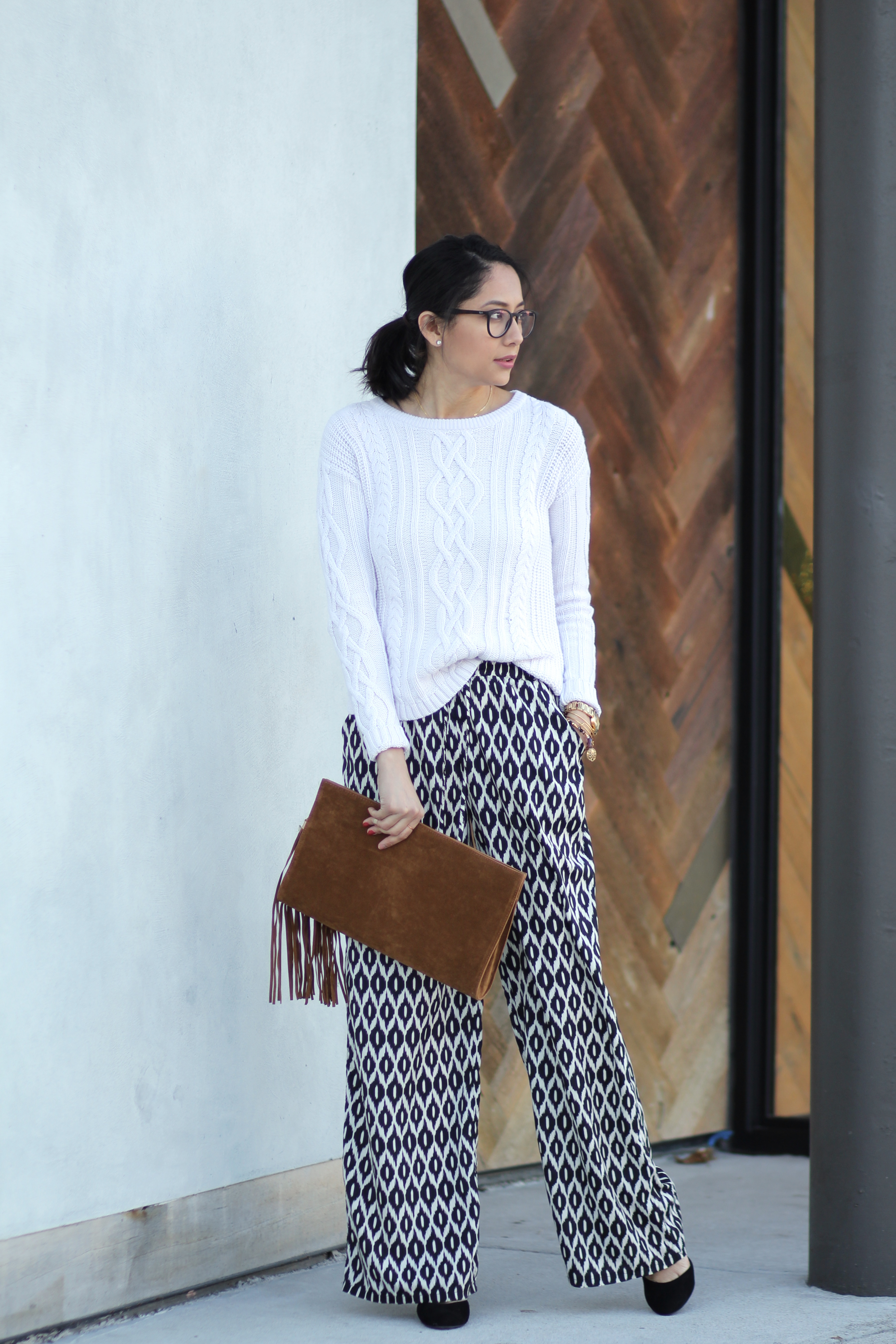Printed pants and cable knit sweater outfit
