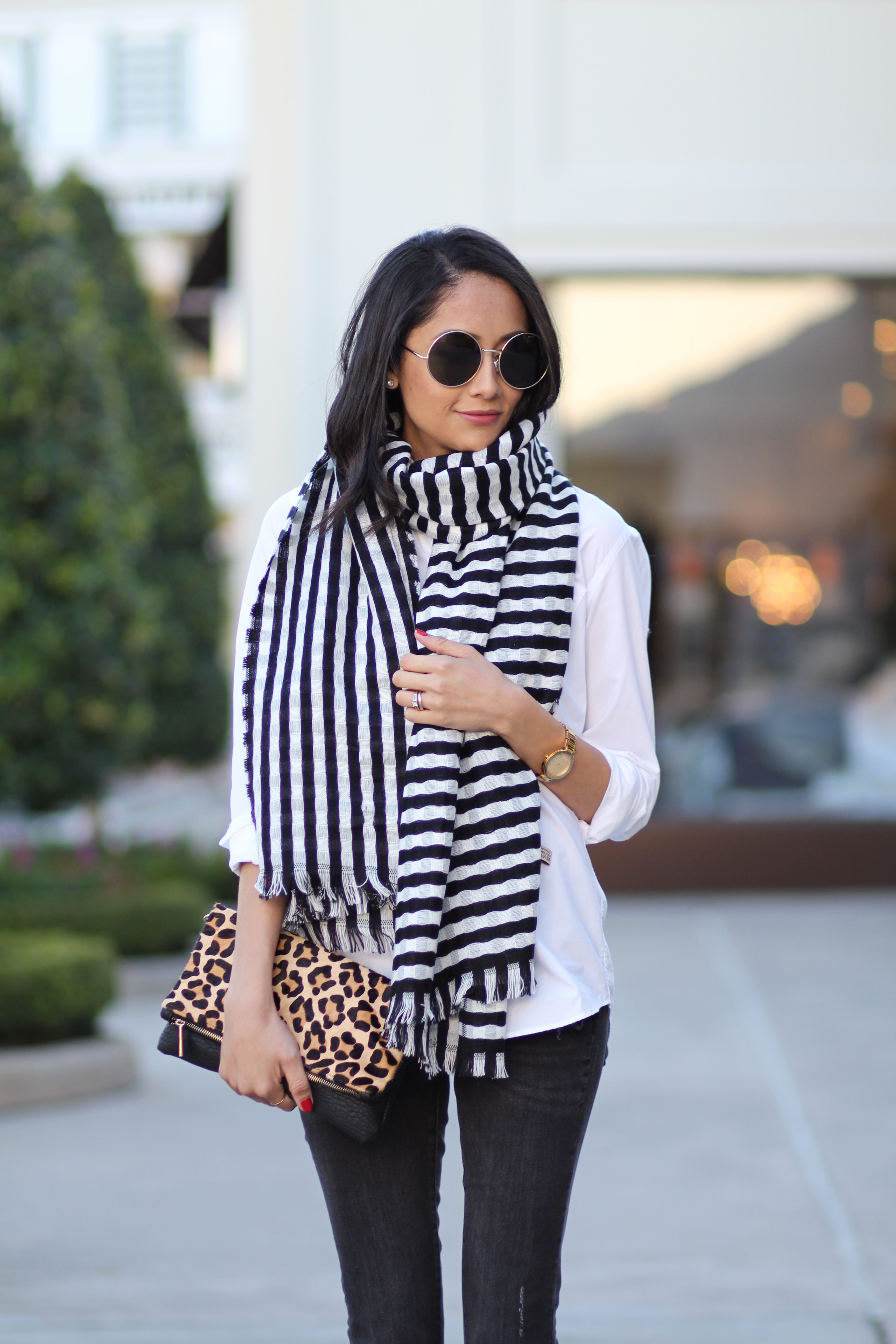 Lifestyle blogger Lilly Beltran of Daily Craving wearing a striped blanket scarf