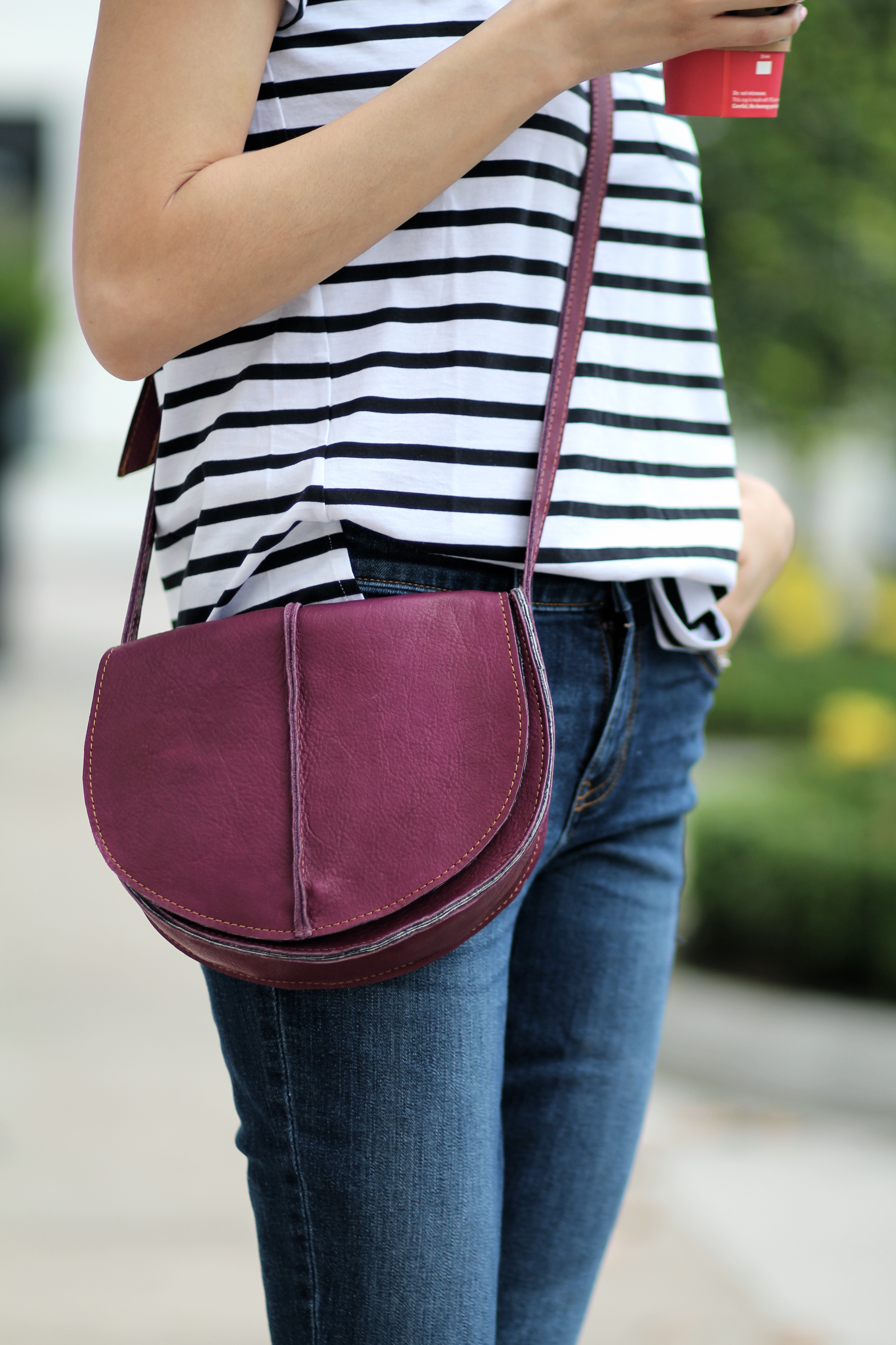 leather raspberry saddle bag by Mari Larsa