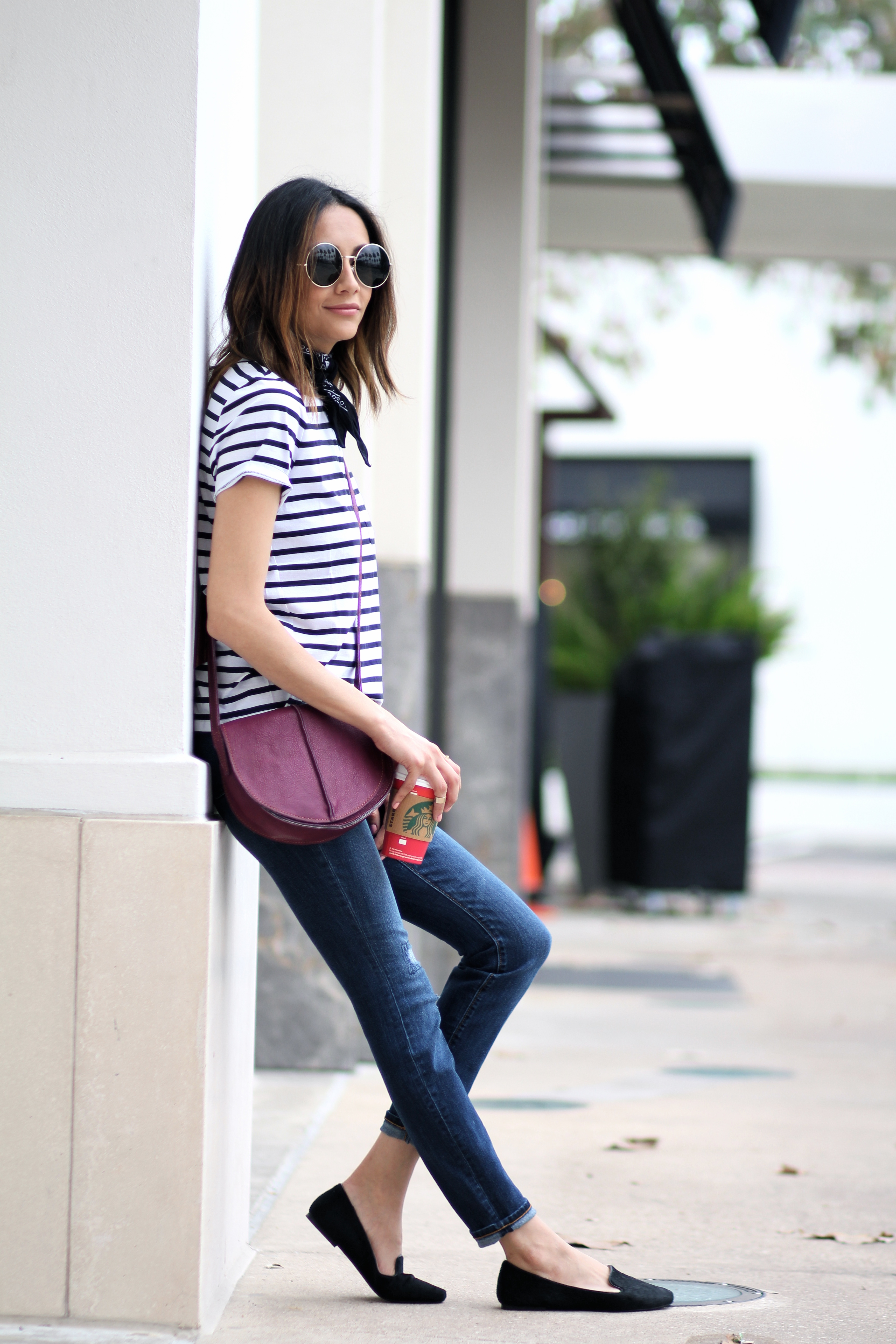 a casual look with a raspberry saddle bag for a pop of color