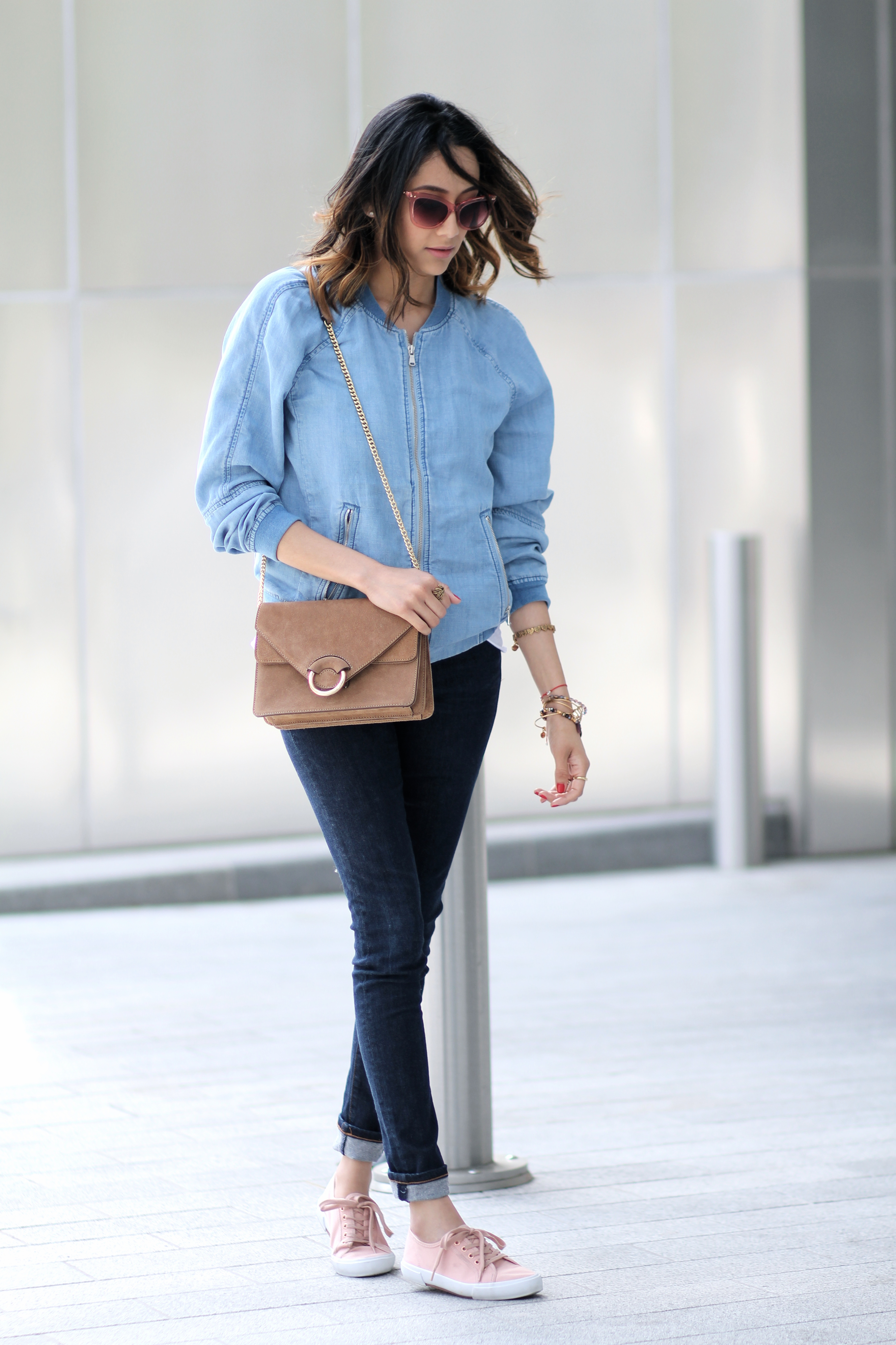 A casual Friday look wearing a denim bomber jacket