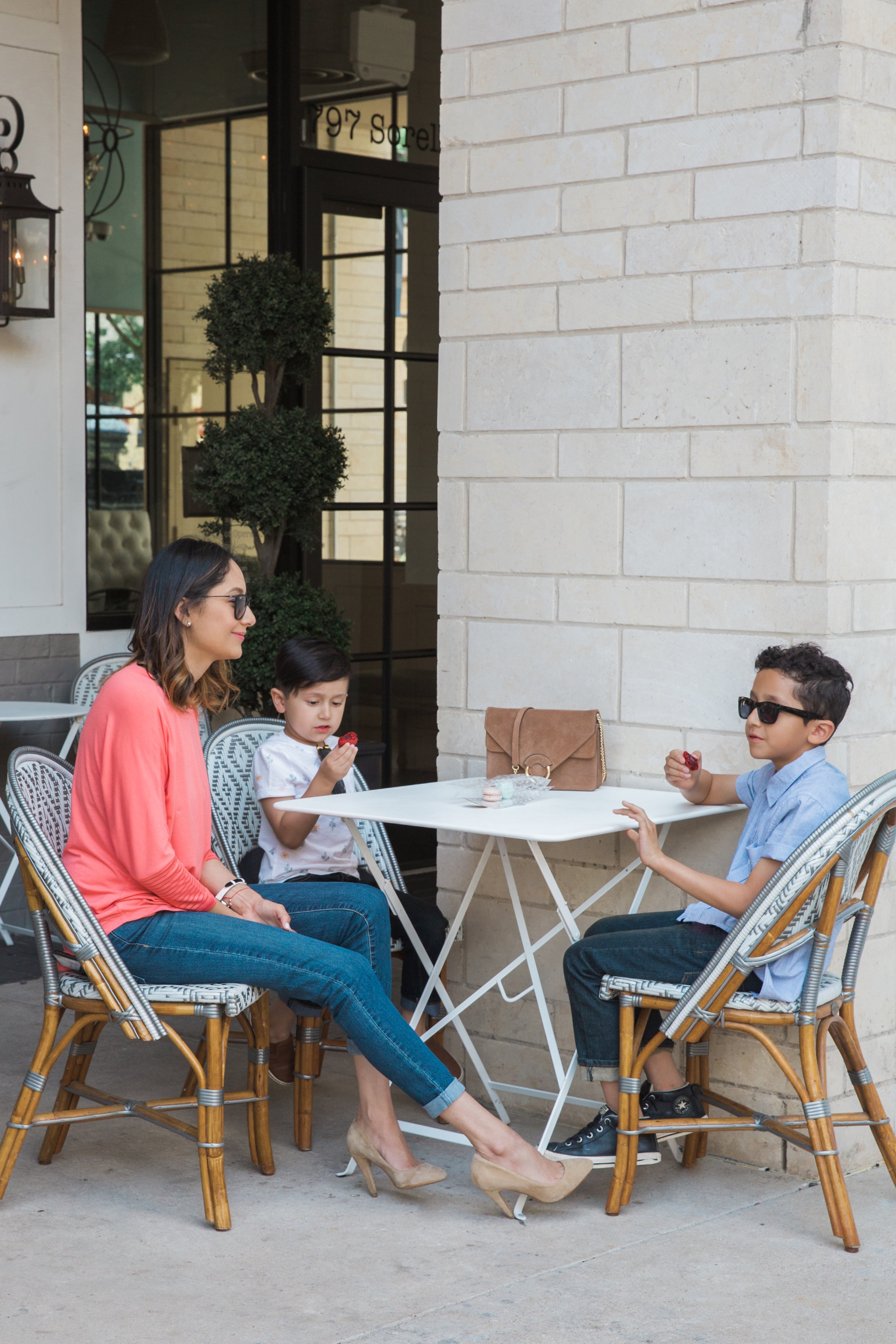Lifestyle blogger Lilly Beltran of Daily Craving on a family brunch with her boys wearing a casual look with mom jeans and nude heels