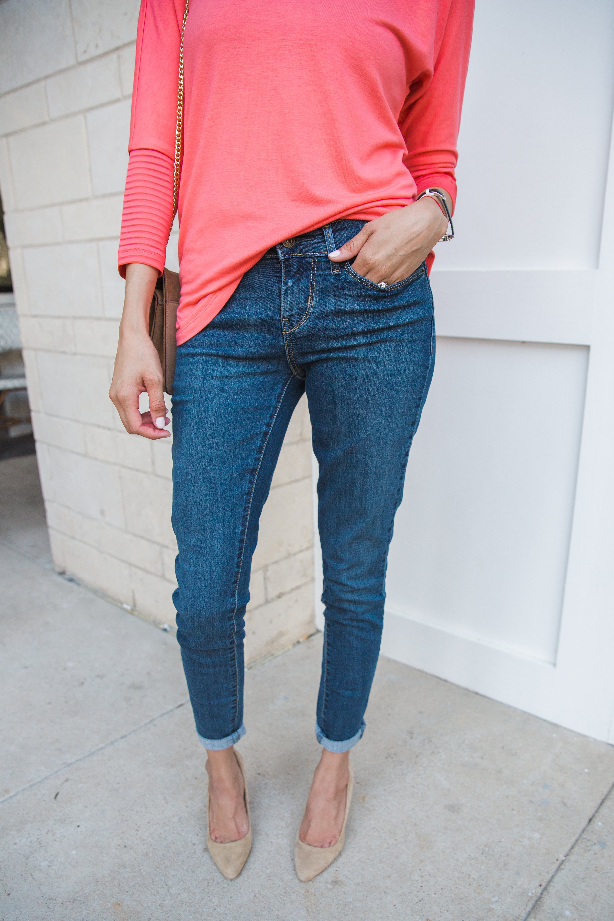 Lifestyle blogger Lilly Beltran of Daily Craving in cuffed skinny jeans and nude high heels