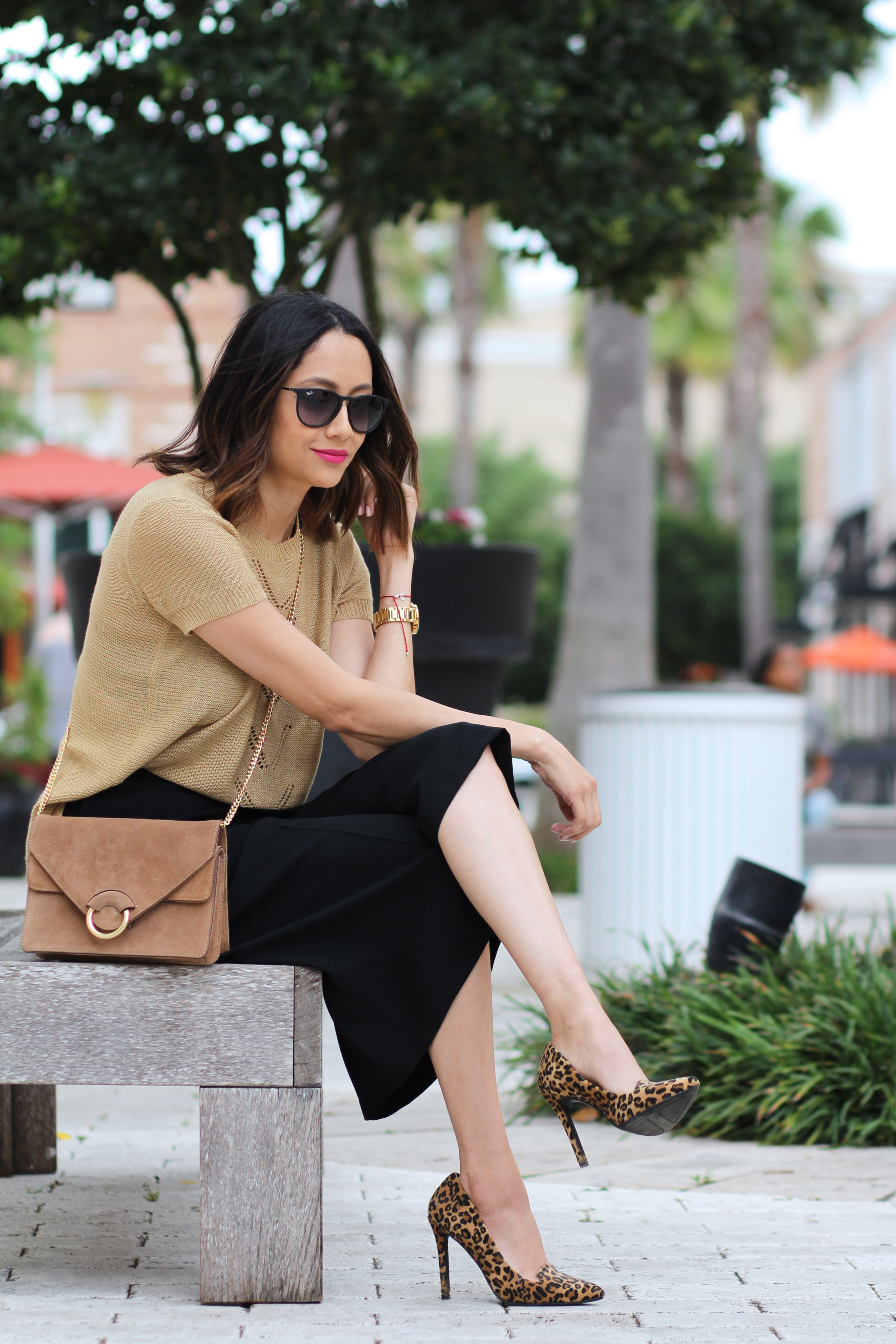 casual in black culottes and tan eyelet top