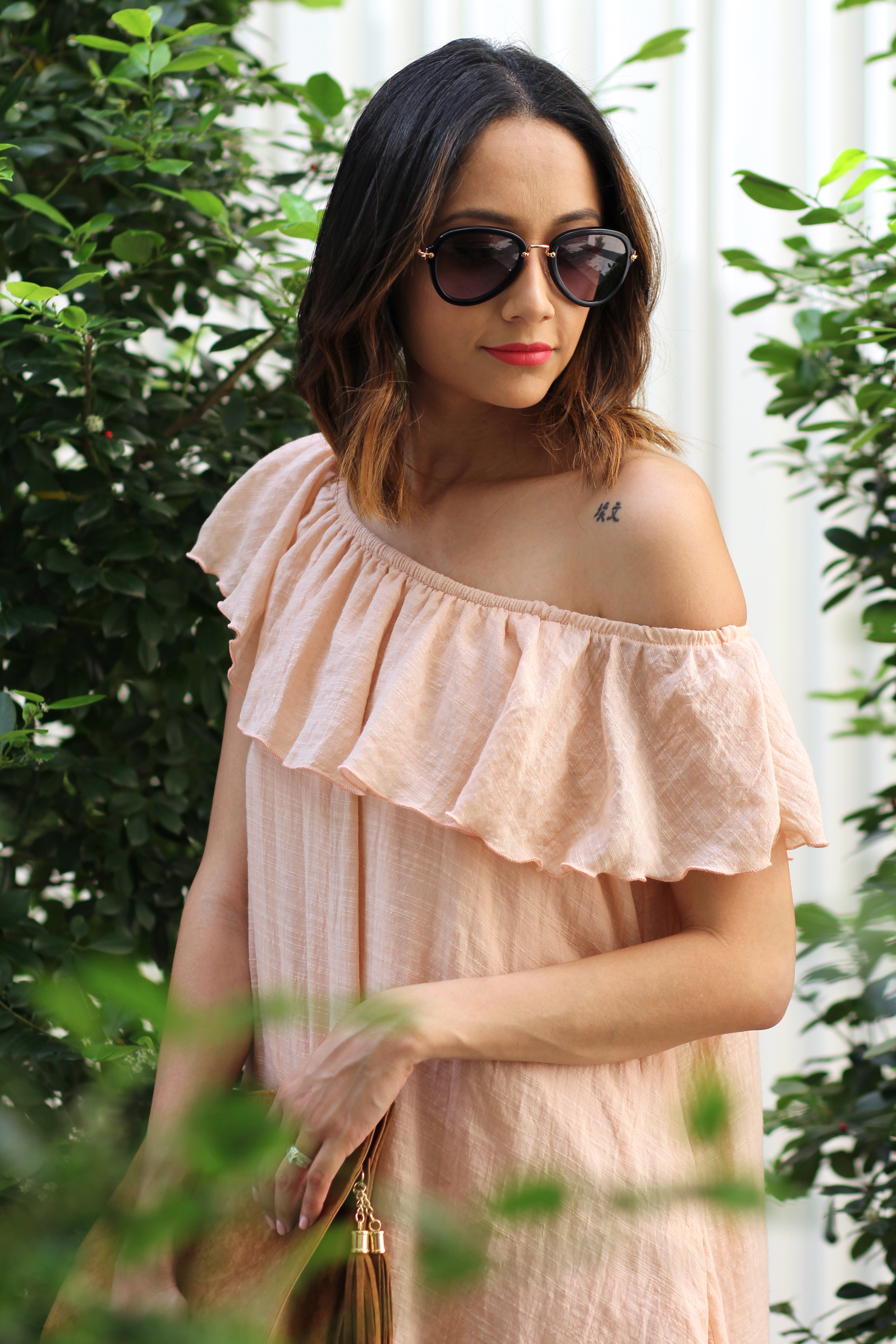 Mui Mui sunglasses paired with a blush off the shoulder dress