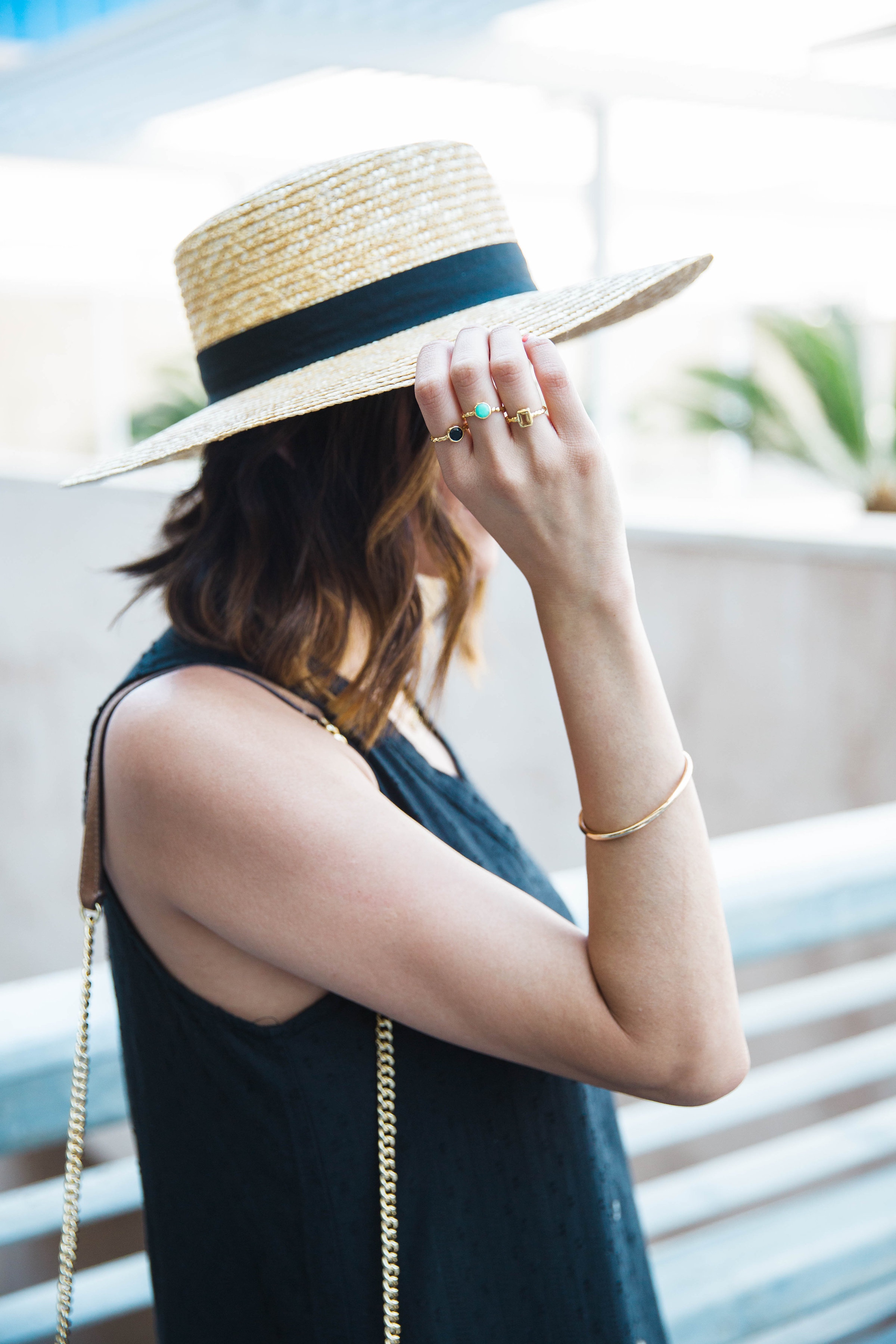 Dainty rings and boater hat