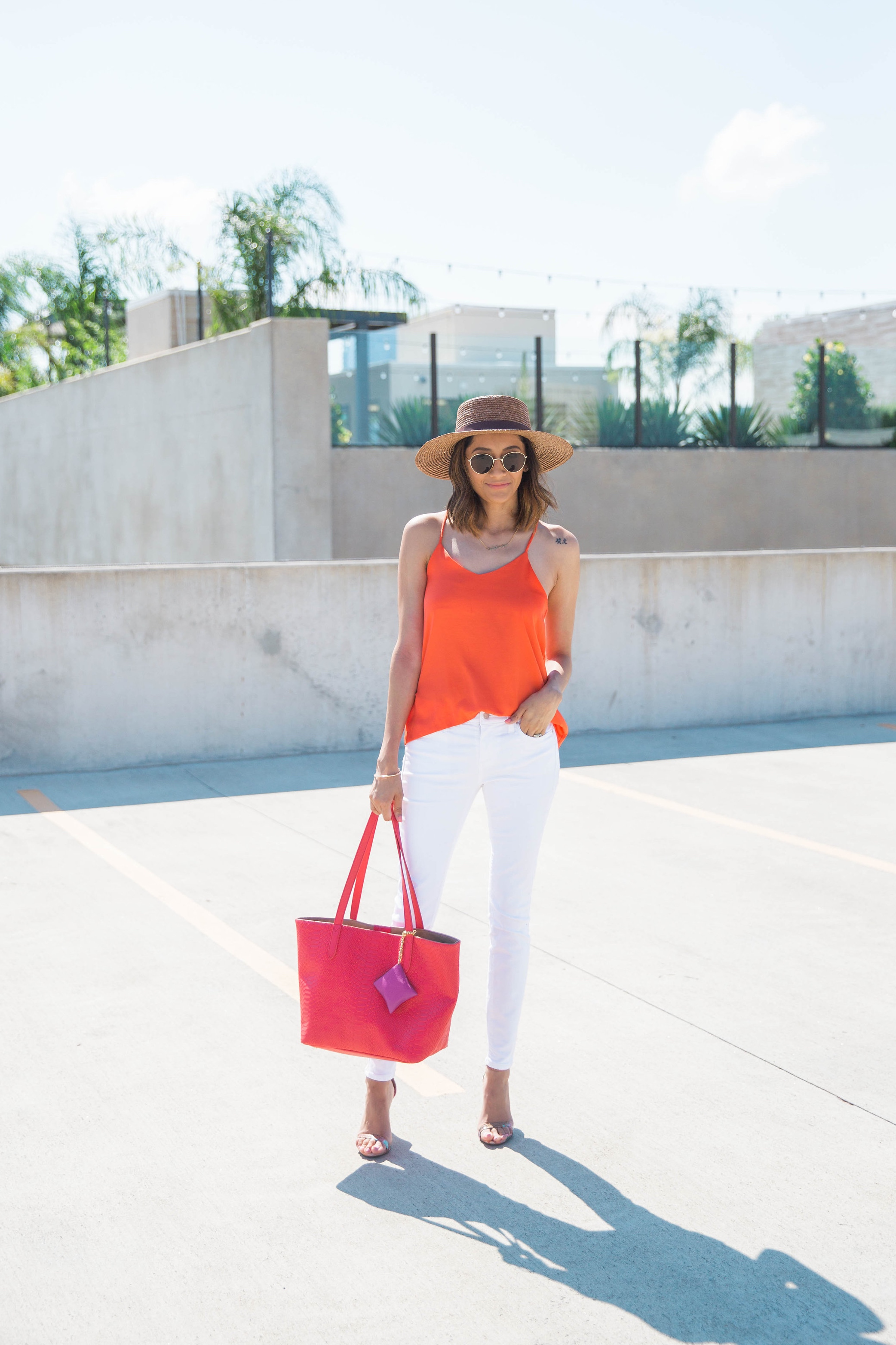 A summer color-blocked look | White Jeans, Orange Cami, Boater Hat & Red Tote