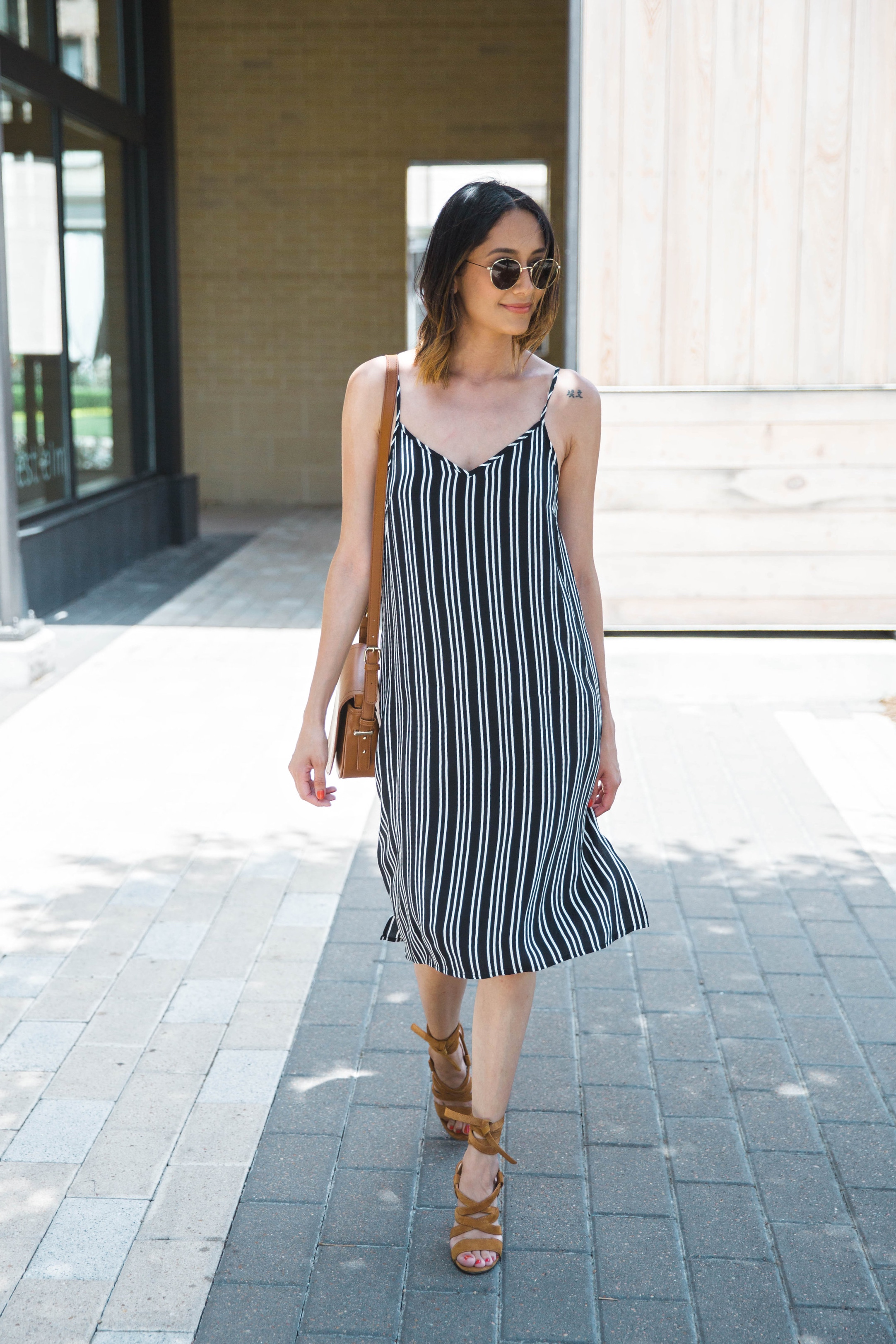 Style blogger Lilly Beltran of Daily Craving wears a black and white slip dress