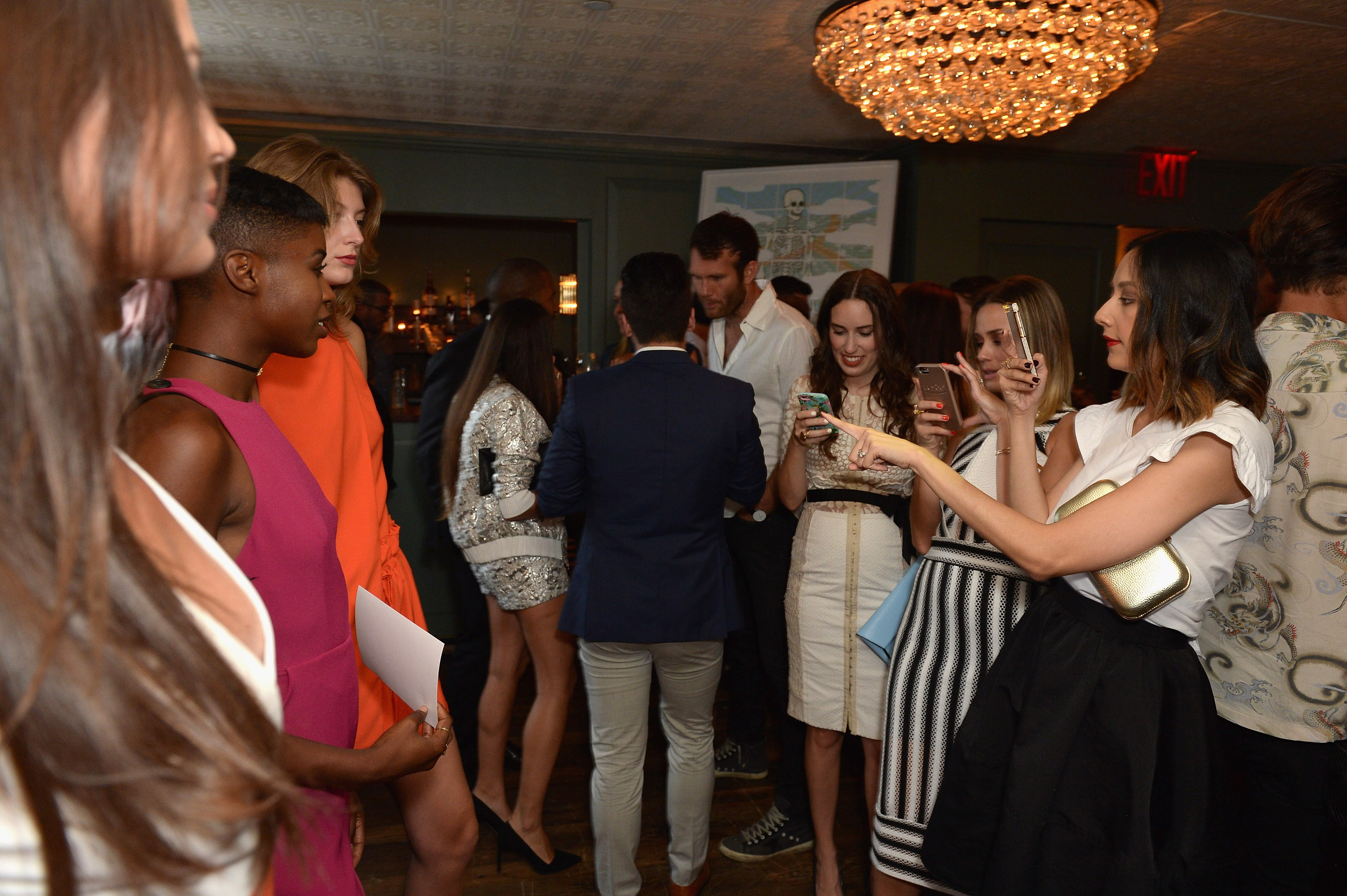 NEW YORK, NY - AUGUST 11: Bloggers photograph models at the Ego Soleil Fashion Label Launch of SS17 Fashion Collection in New York City on August 11, 2016 in New York City. (Photo by Andrew Toth/Getty Images for Ego Soleil)