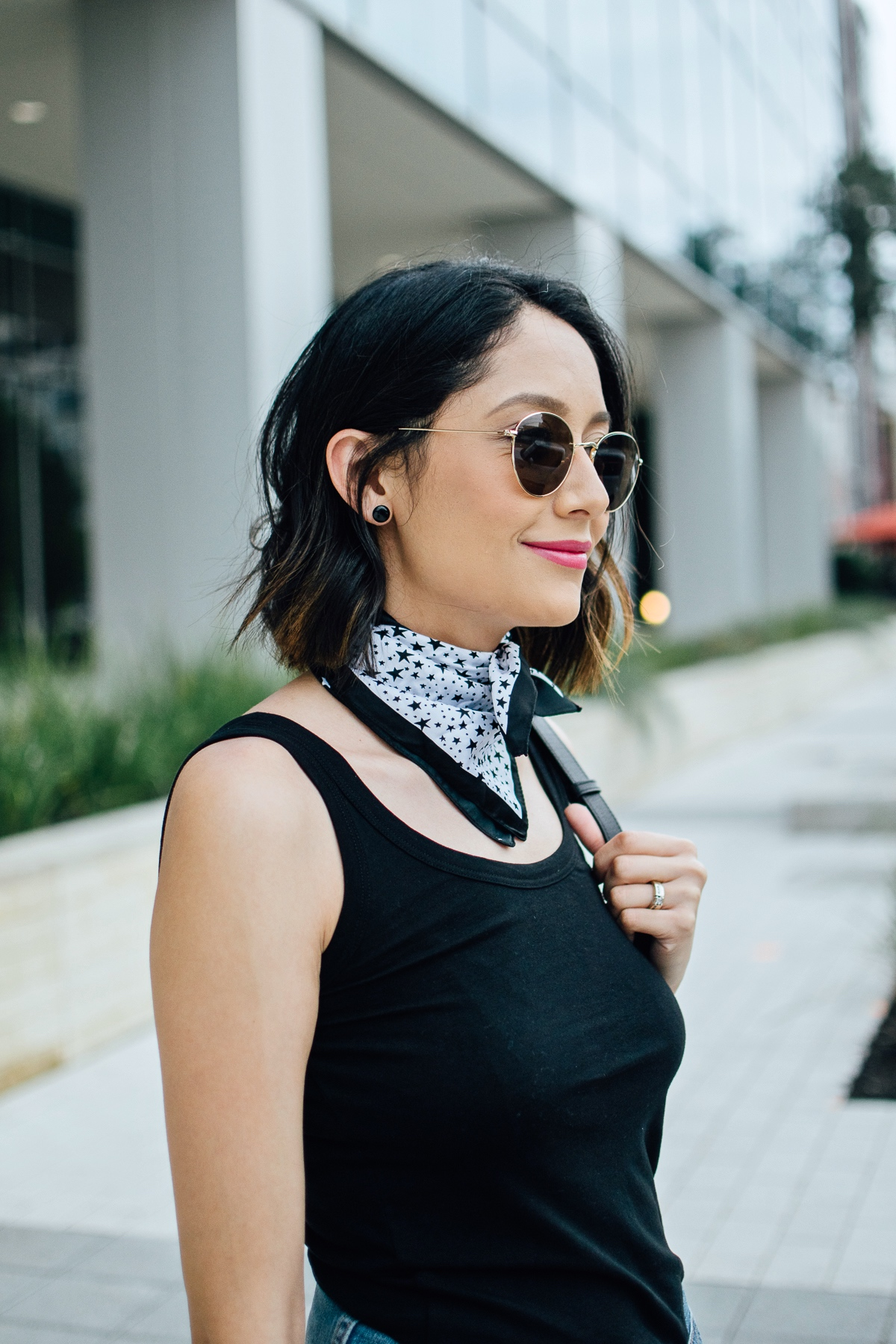 Style blogger Daily Craving wearing a black and white neck bandana