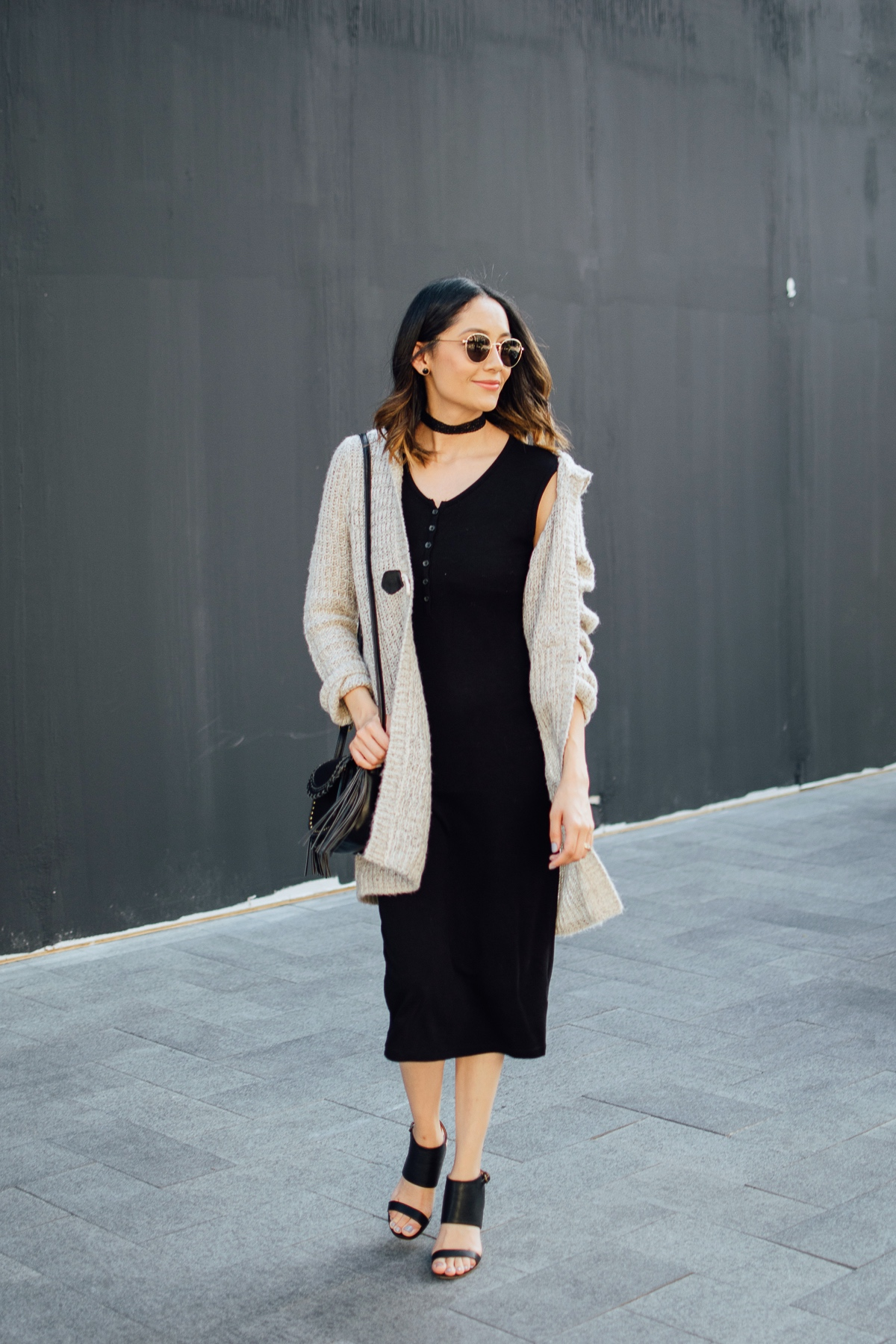 Style blogger Lilly Beltran wearing a casual fall outfit with a midi dress, beige cardigan and velvet choker