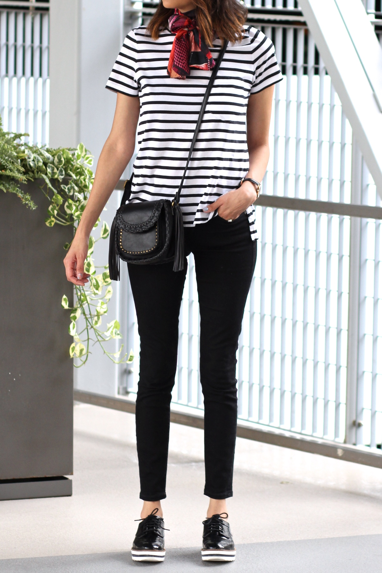 Lilly Beltran of Daily Craving blog wearing a striped tee and black Zara shoes