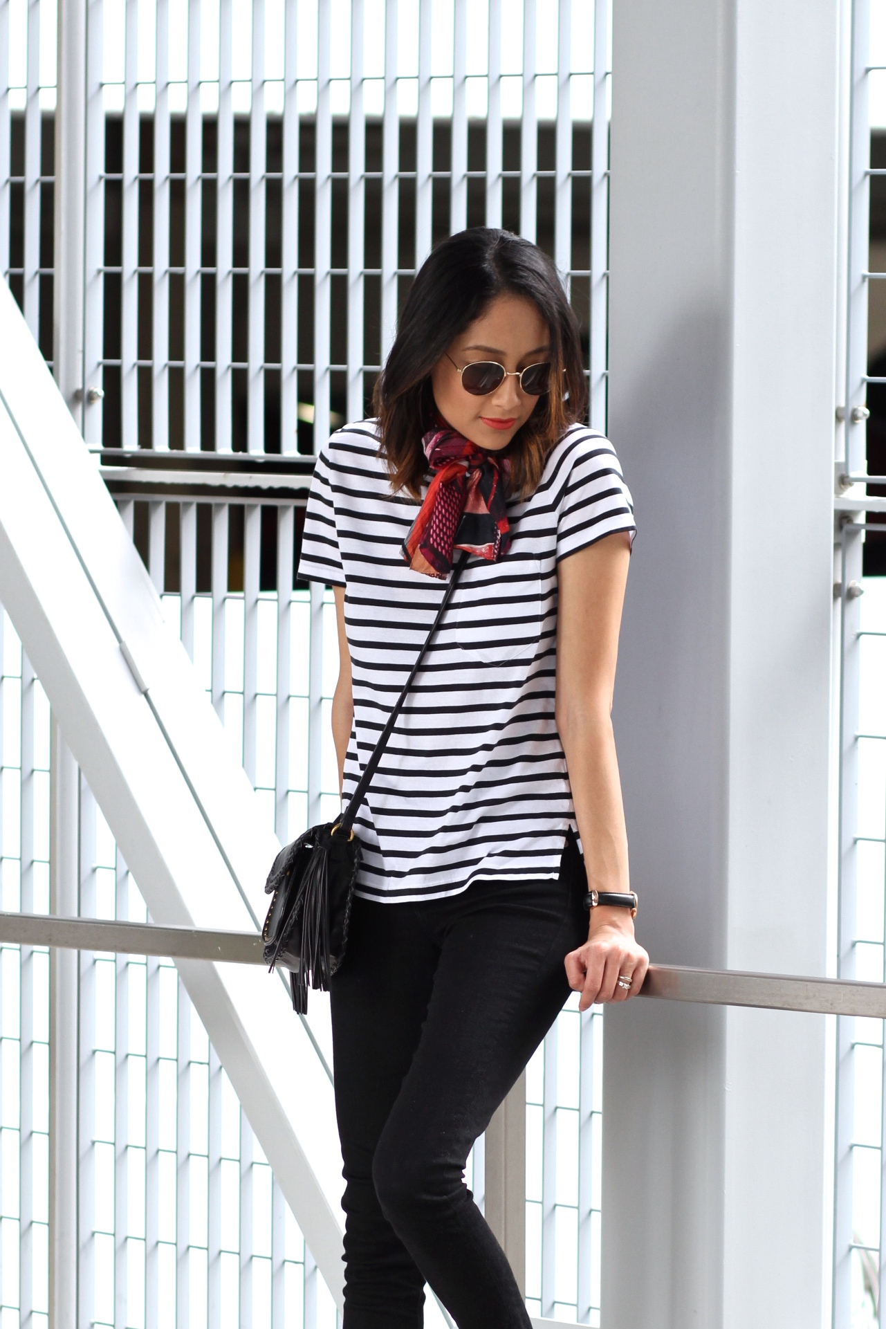 Lilly Beltran of Daily Craving blog wearing a striped tee and black denim jeans