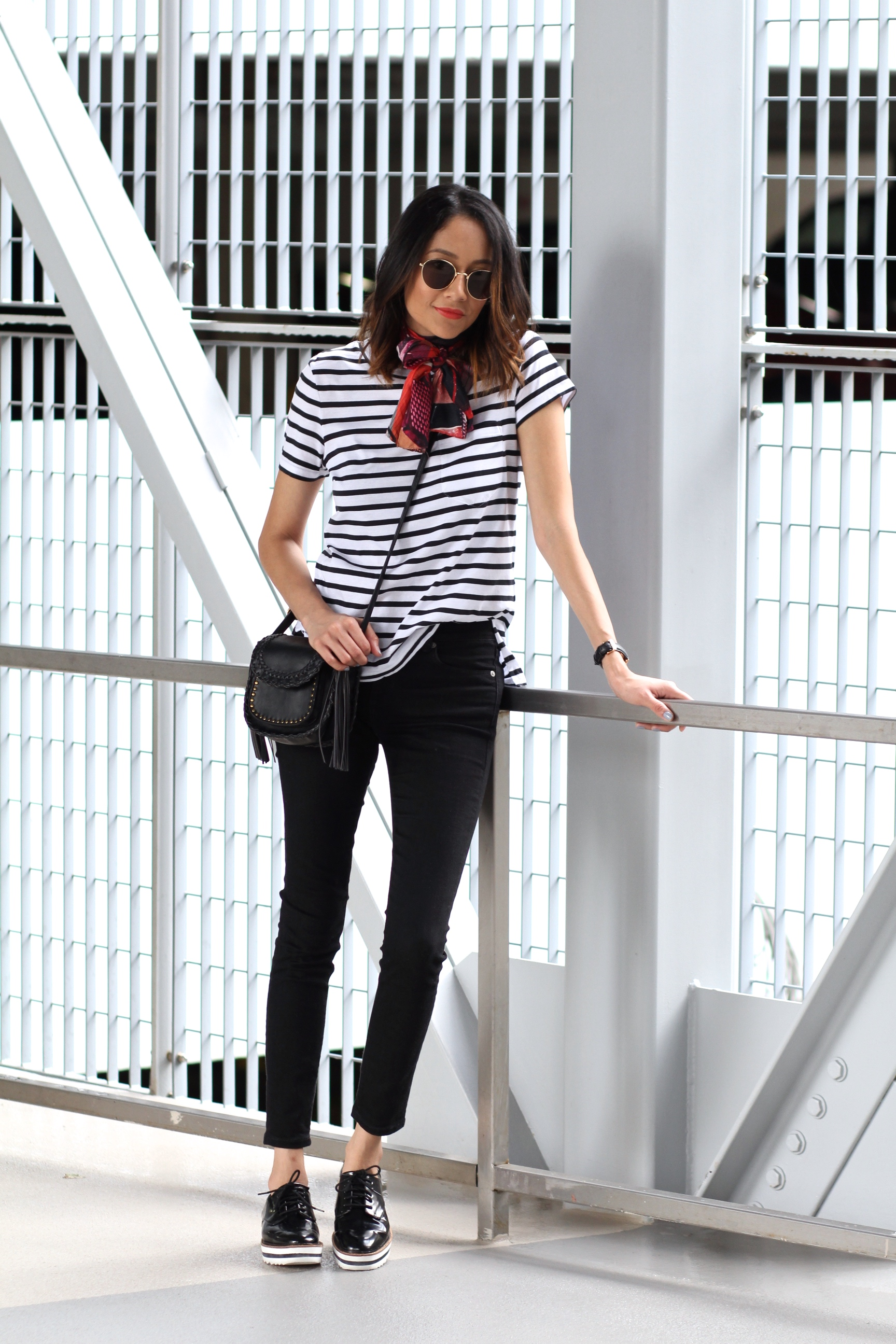 Lifestyle blogger Lilly Beltran from Daily Craving wearing a striped tee and scarf