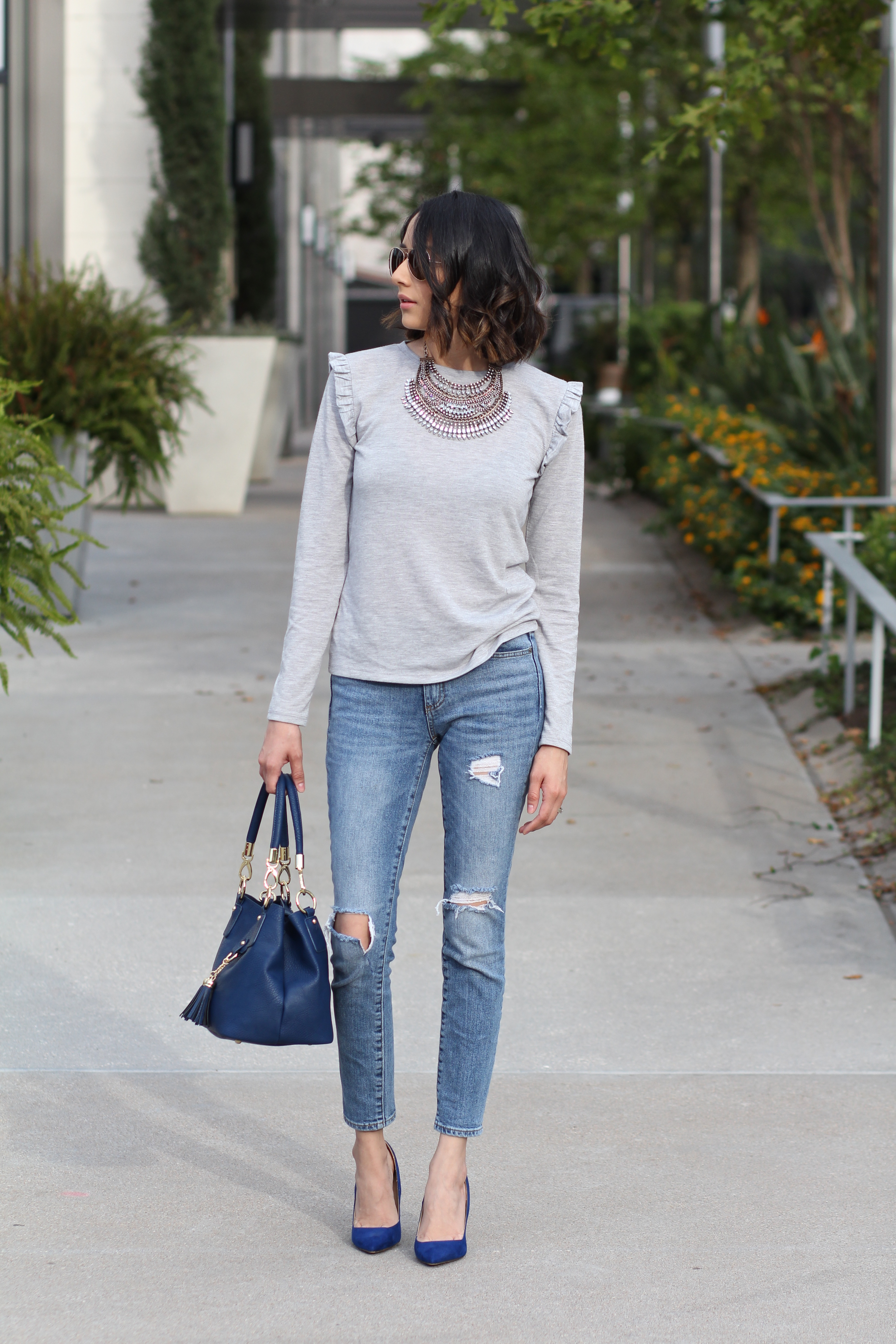 Ruffle top, ripped jeans & statement necklace