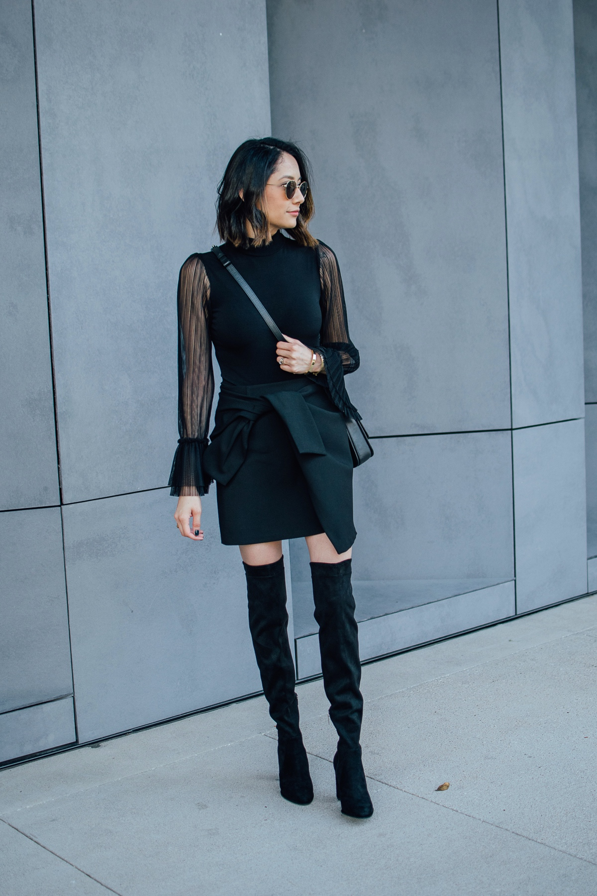 Style Blogger Lilly Beltran wearing OTK boots, black mini skirt and bell sleeve bodysuit