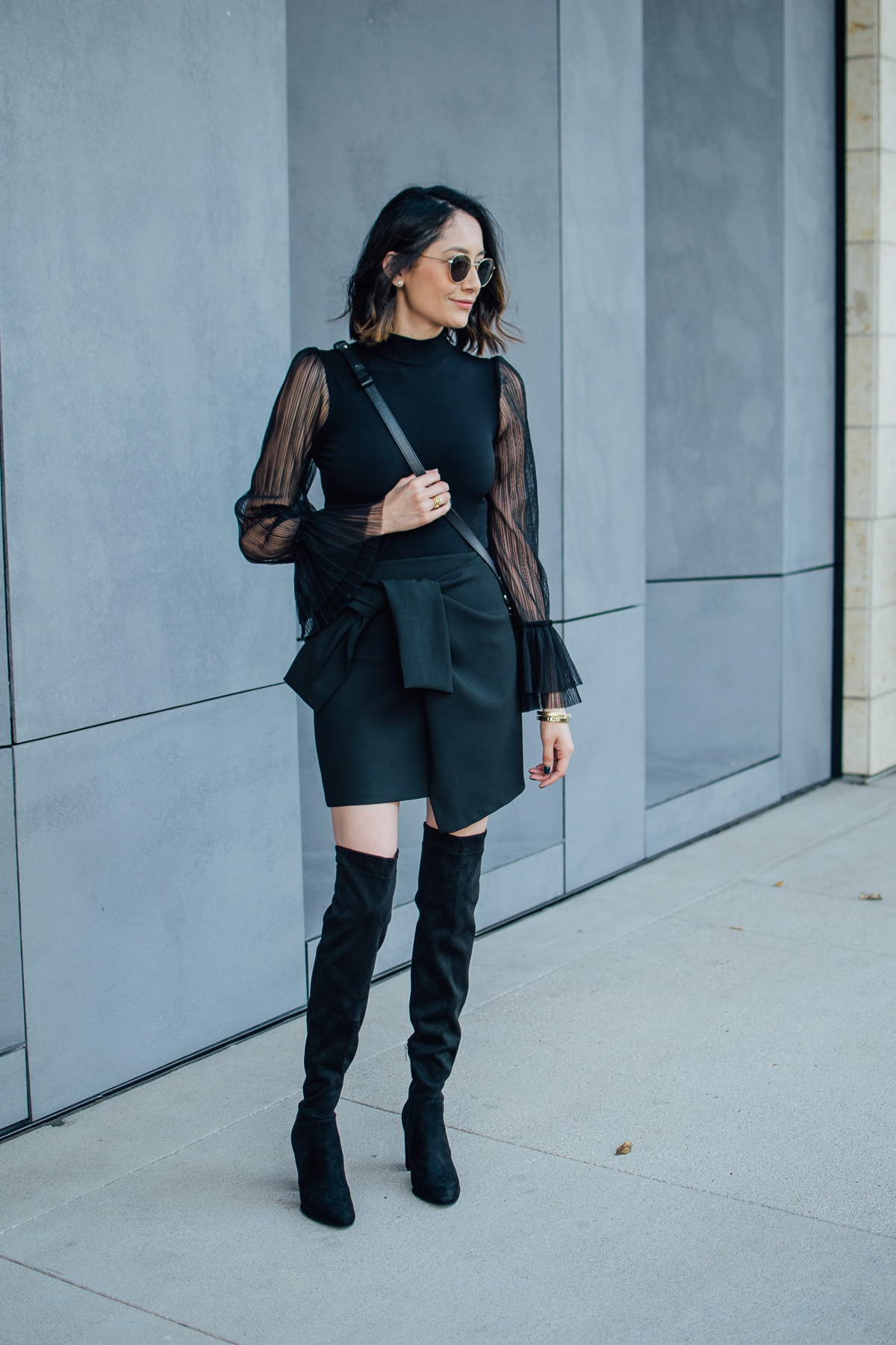 Daily Craving wearing a chic fall look with suede OTK boots and a black wrap skirt