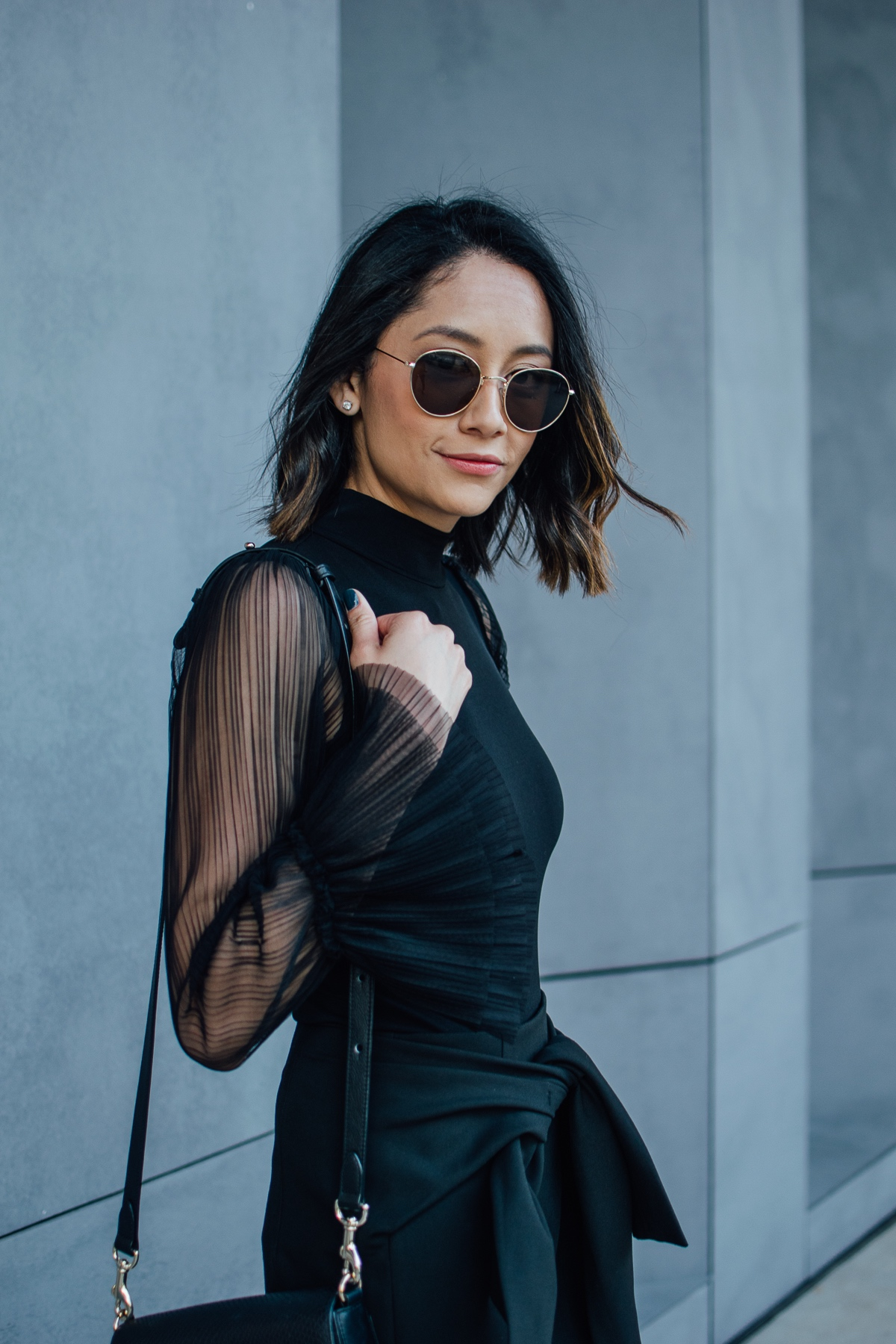 Lilly Beltran of Daily Craving wearing a bodysuit with sheer bell sleeves