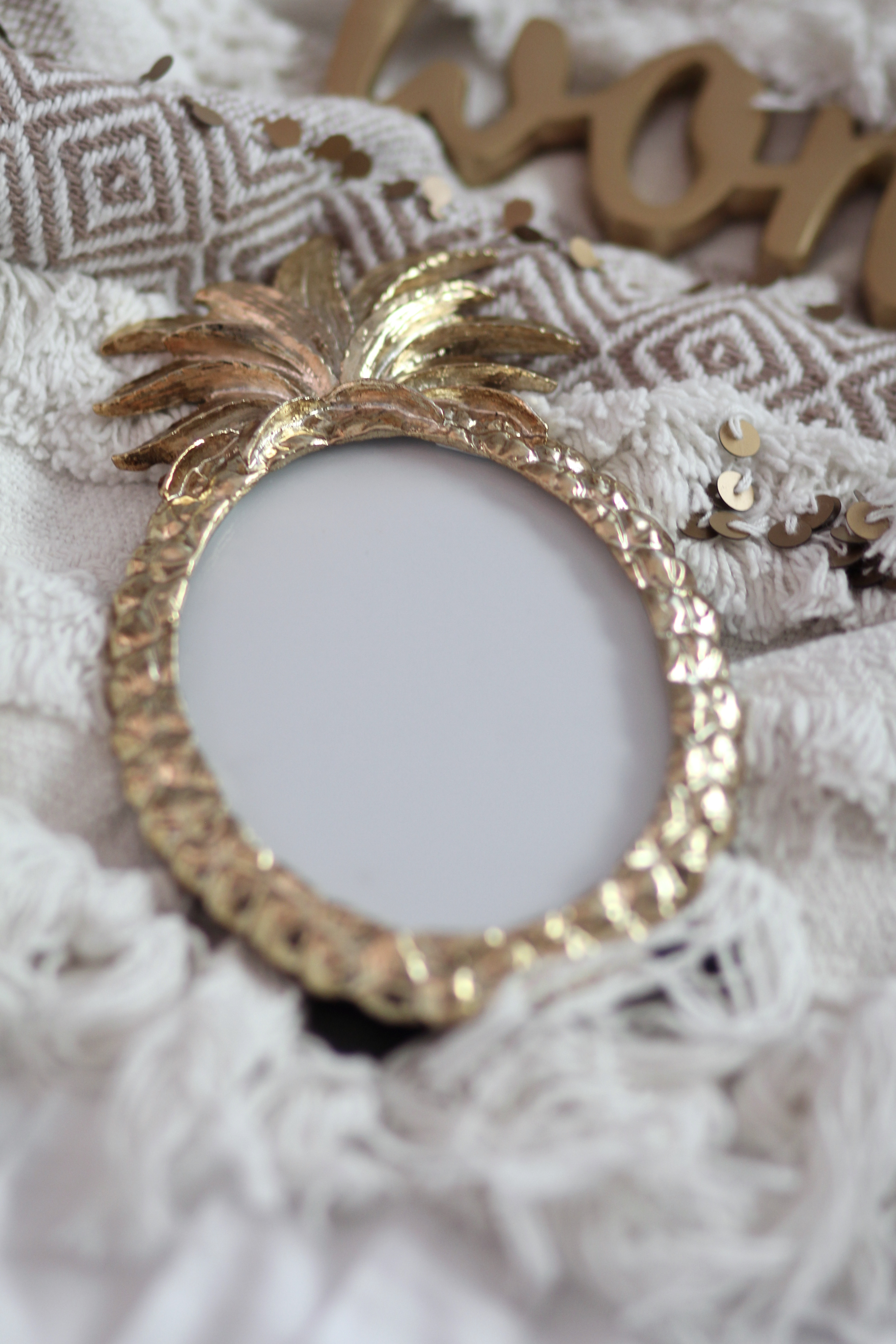 Gold pineapple picture frame from Marks & Spencer