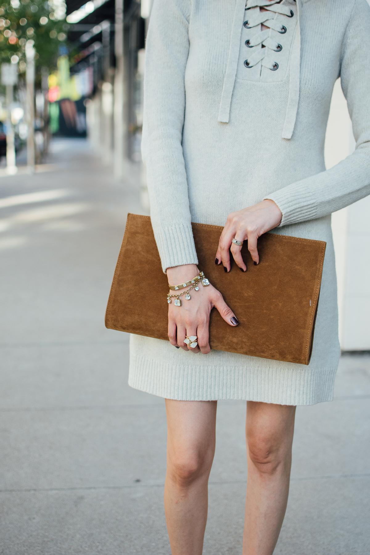 lace up sweater dress & suede clutch