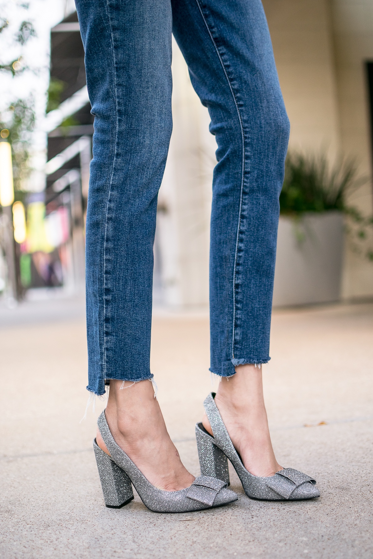 Style blogger Lilly Beltran of Daily Craving wearing silver glitter heels