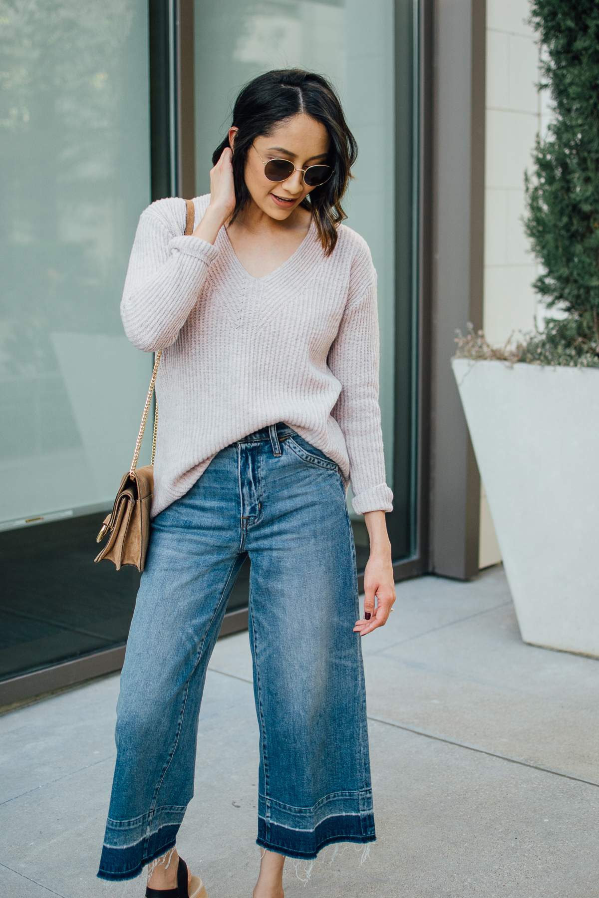 Daily craving wearing wide leg denim with undone hems and a blush cashmere sweater
