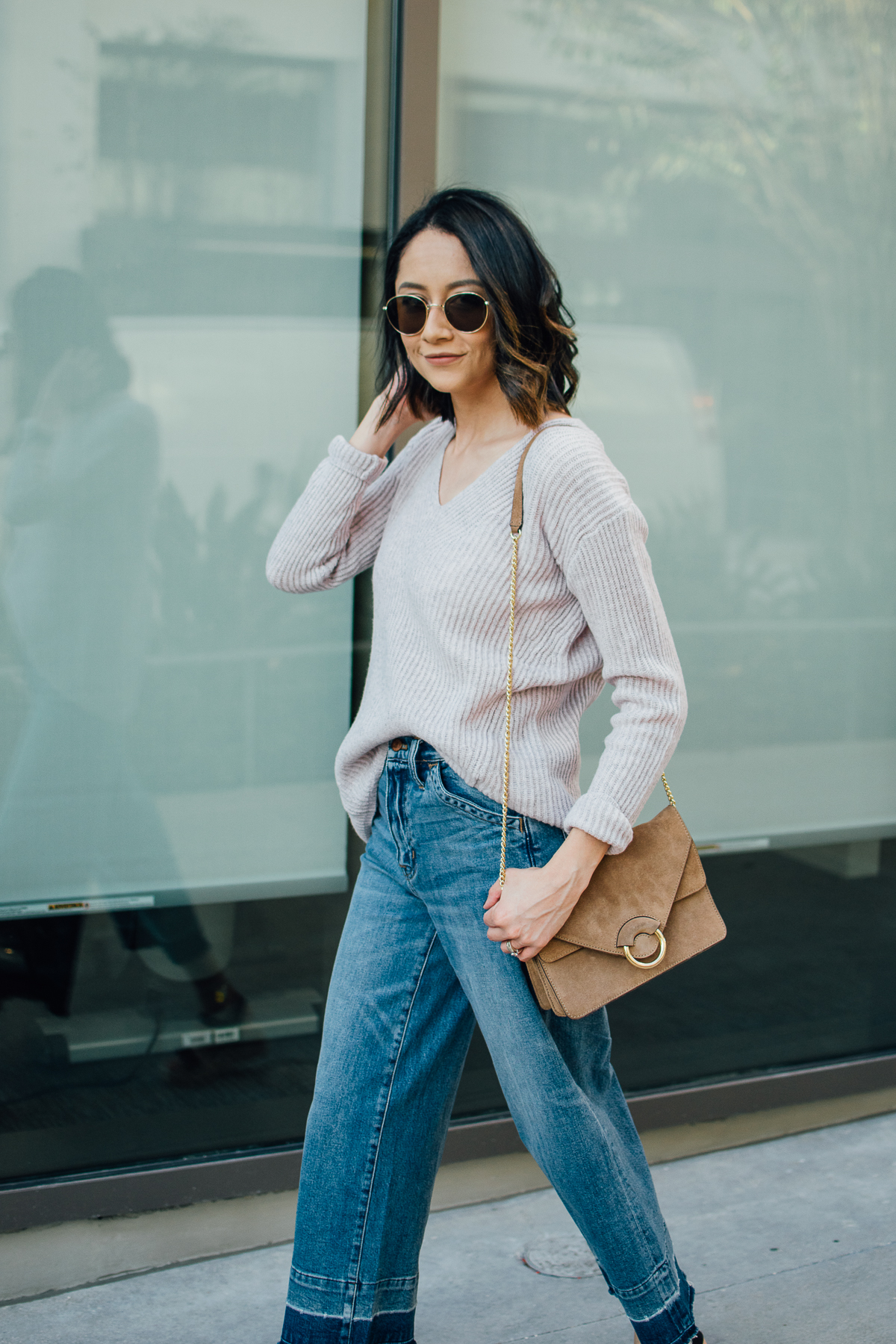 Lilly Beltran of Daily Craving styles wide leg denim with a blush sweater