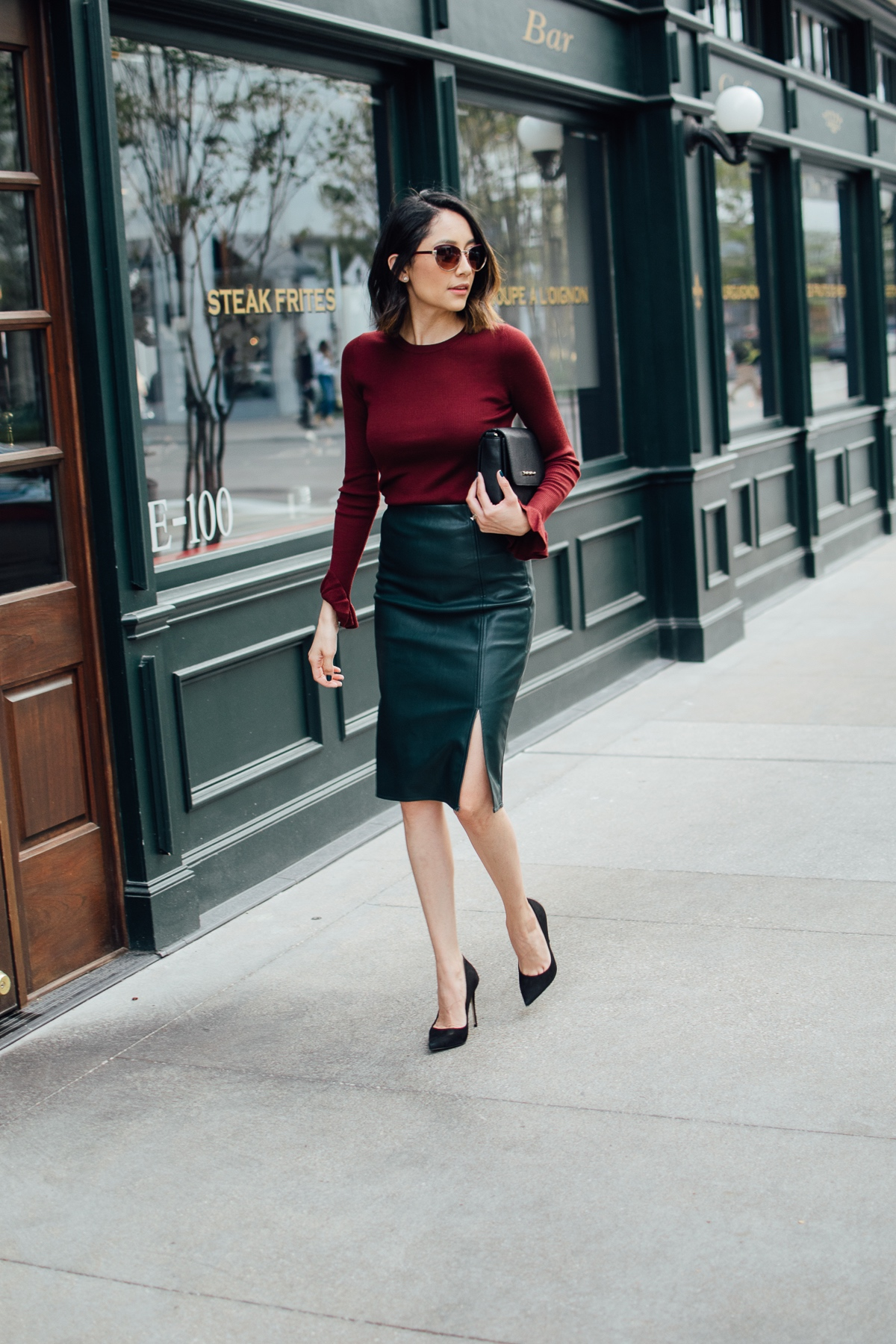 Daily Craving in a street chic holiday ready look with a leather skirt and bell sleeve top