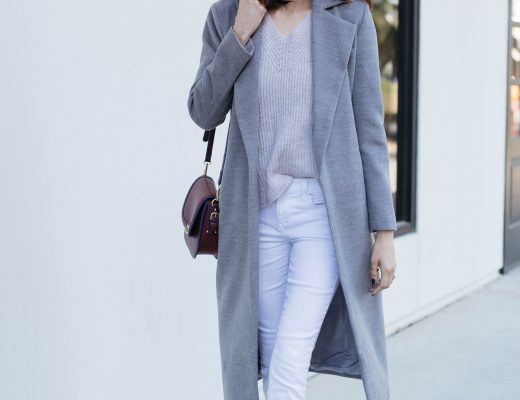 Lifestyle blogger Lilly Beltran of Daily Craving wearing a chic fall look with a grey coat, pink sweater, white denim and black pumps