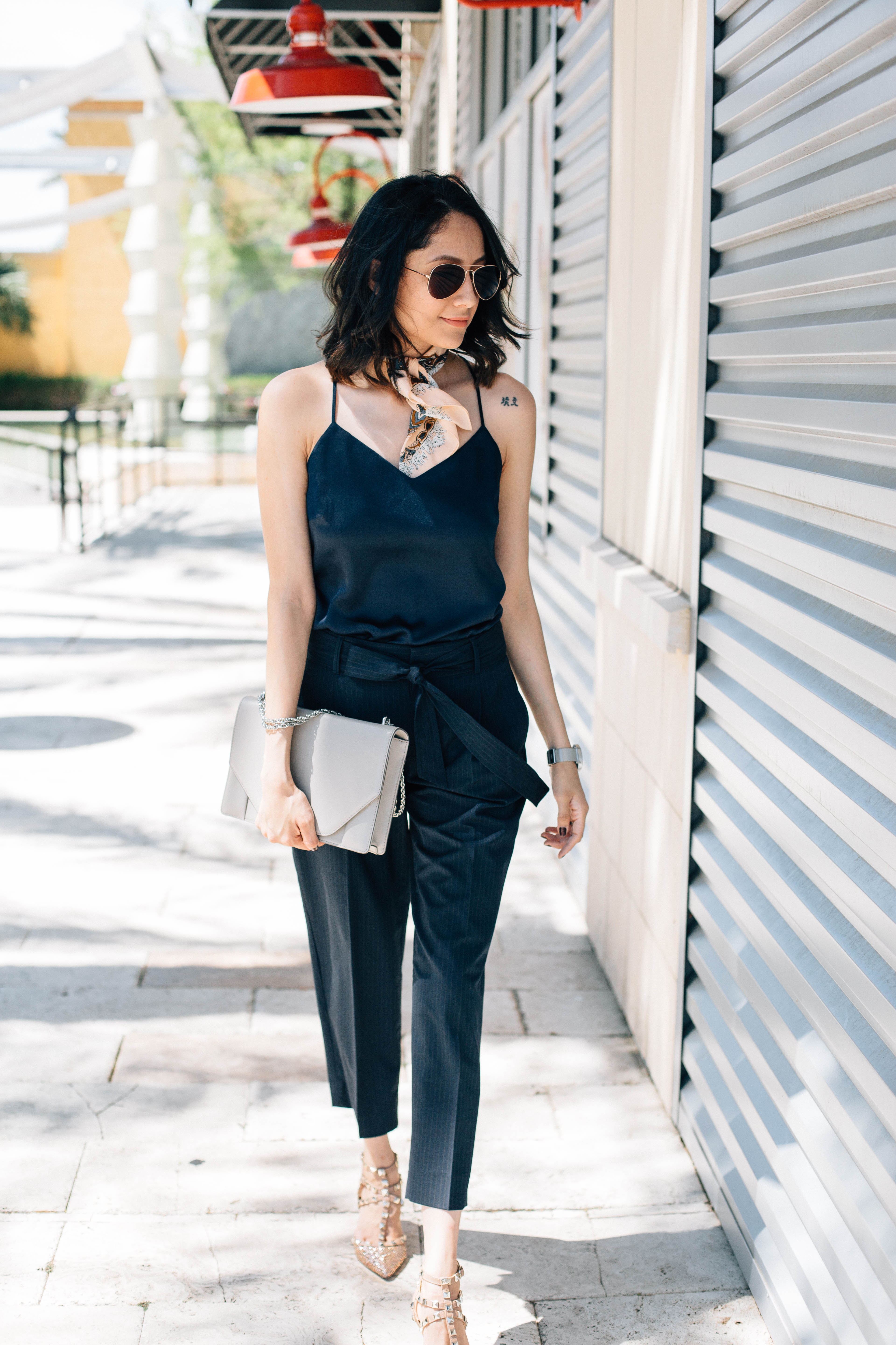 Daily Craving wearing chic pinstripe pants with a navy silk camisole