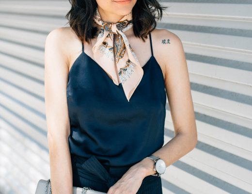 Fashion blogger Lilly Beltran of Daily Craving in chic pants and a navy silk camisole