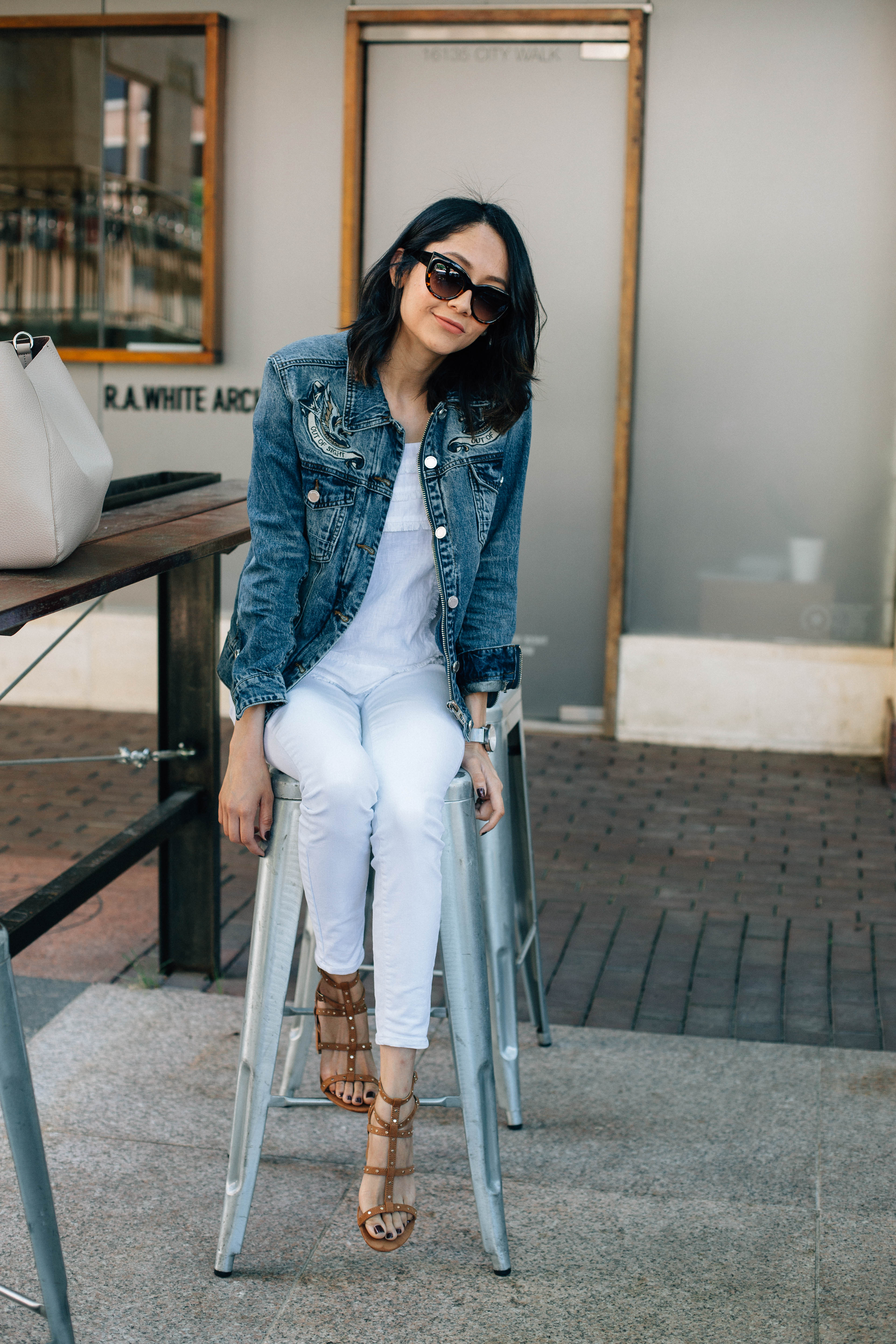 Houston Lifestyle blogger Lilly Beltran in an embroidered denim jacket and white denim