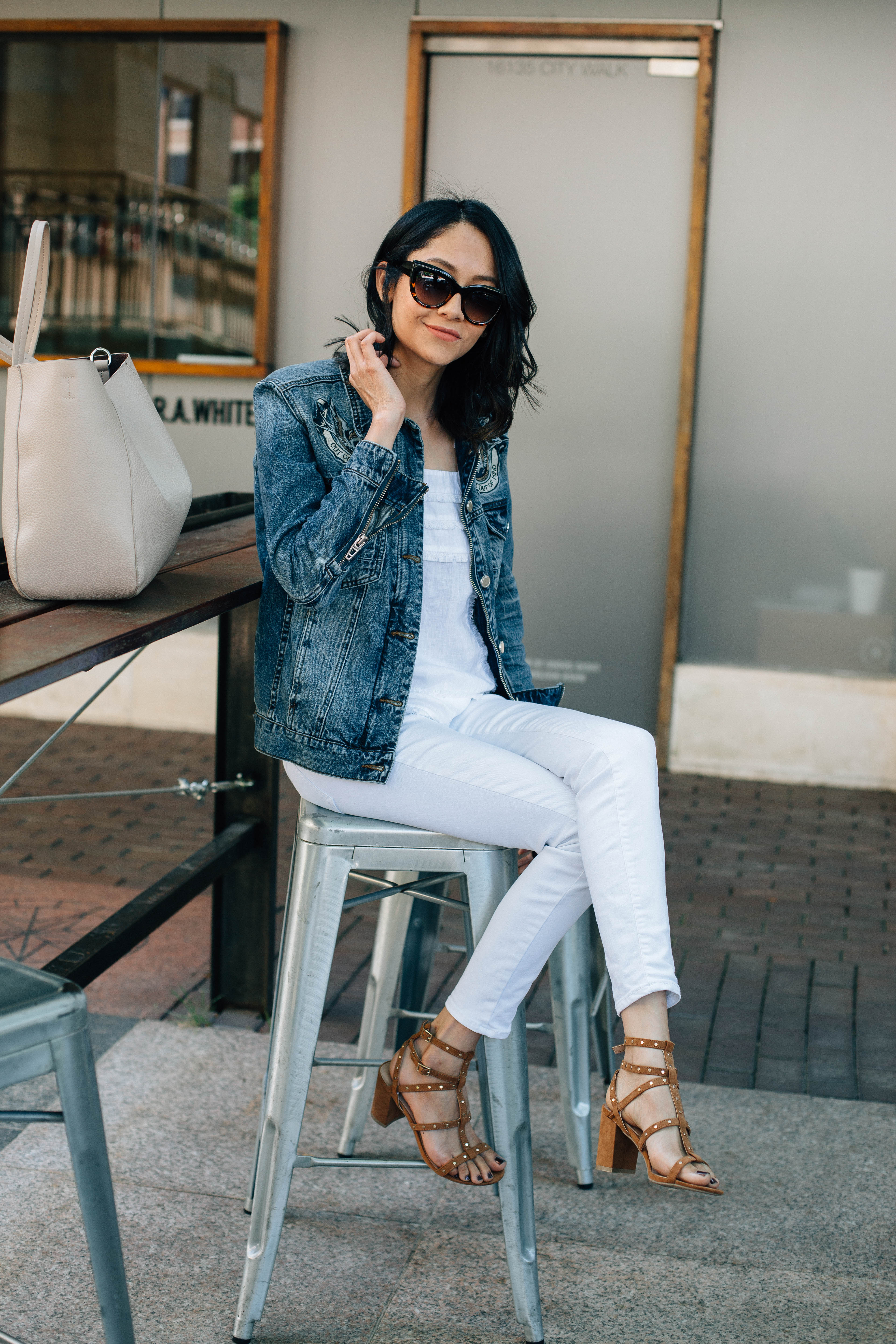 Lilly Beltran of Daily Craving blog in a casual fall look with white skinny jeans and oversized denim jacket