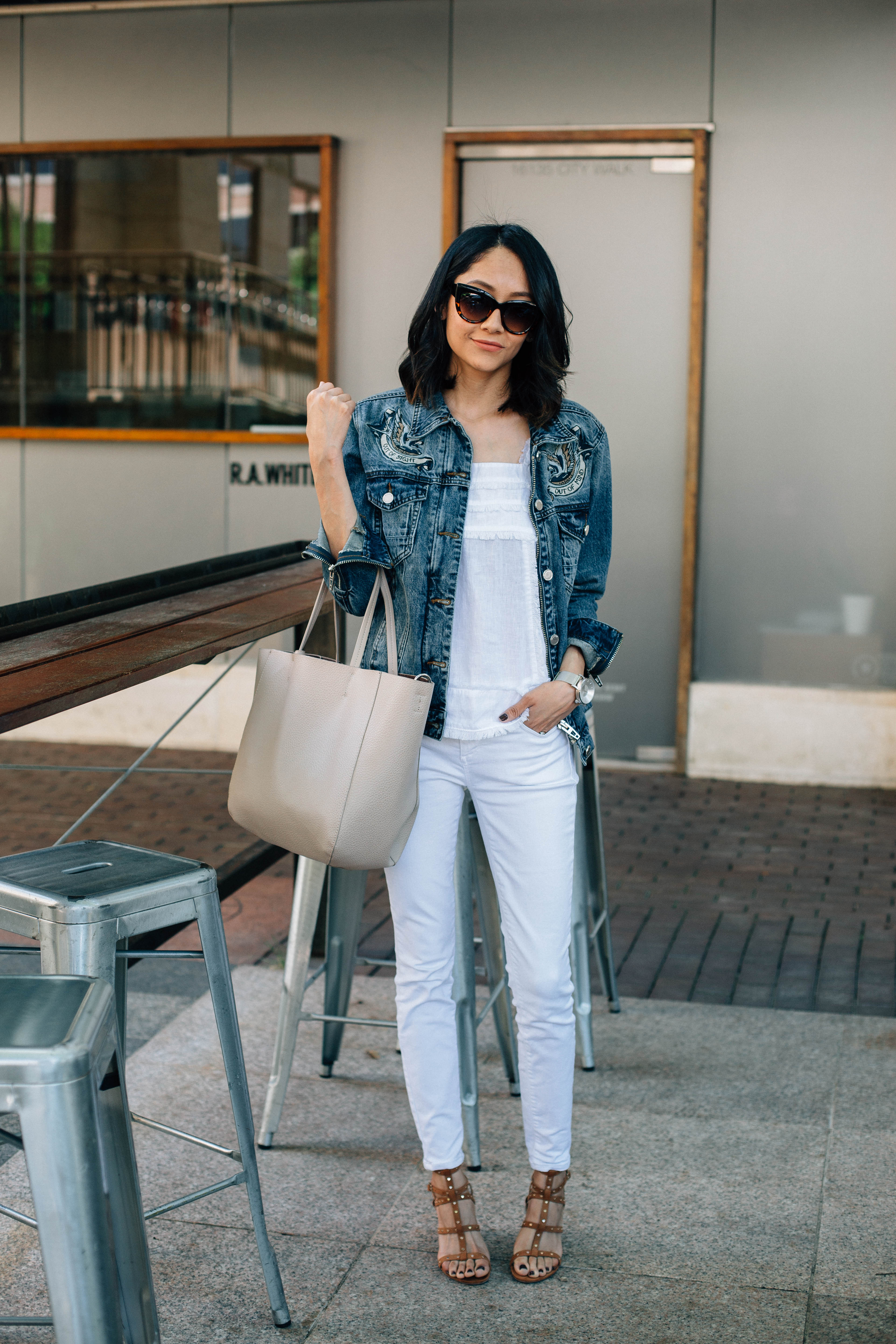 Lilly Beltran of Daily Craving blog wearing an oversized denim jacket with white denim