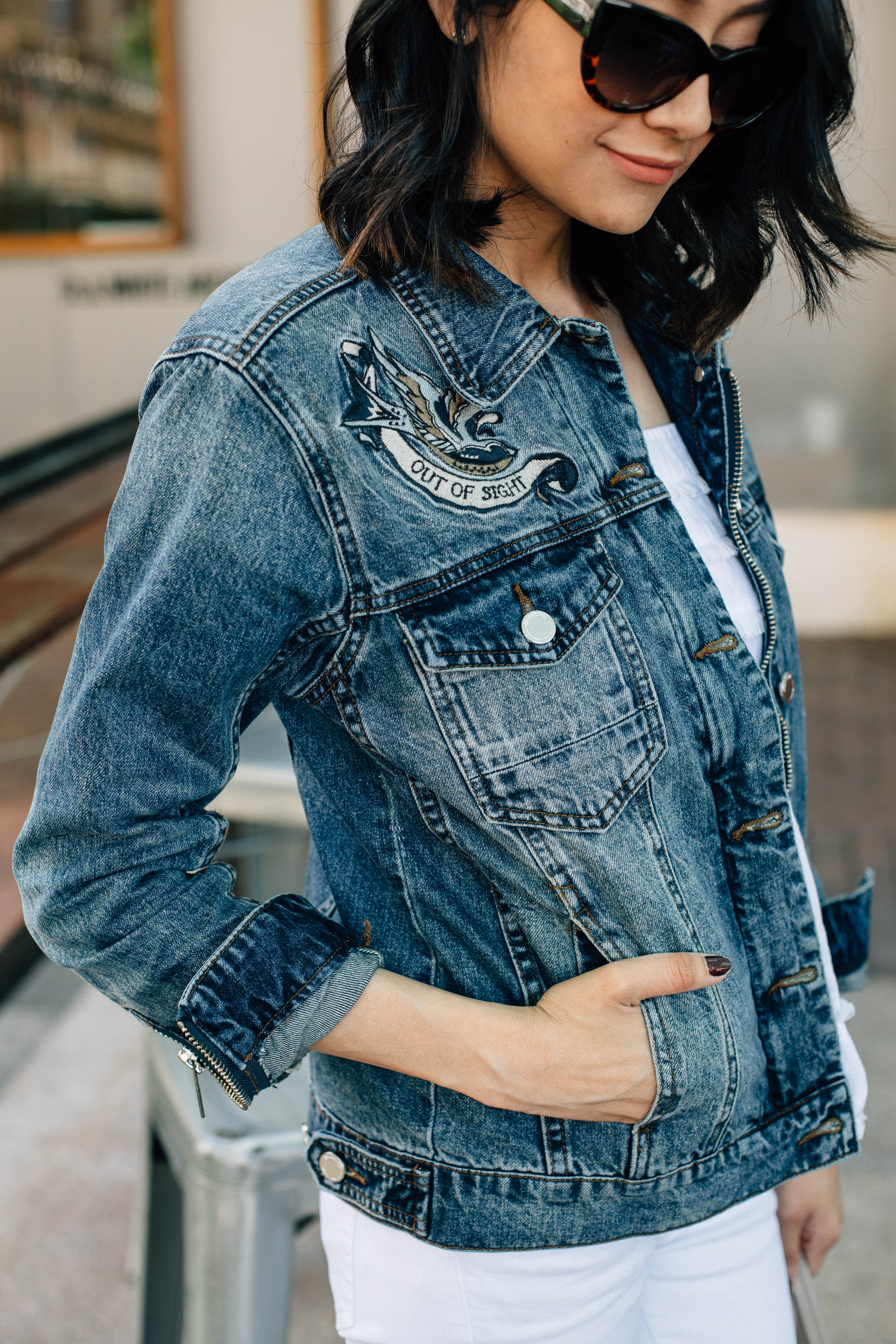 Lilly Beltran of Daily Craving blog wearing an ILY Couture denim jacket and cat eye sunglasses