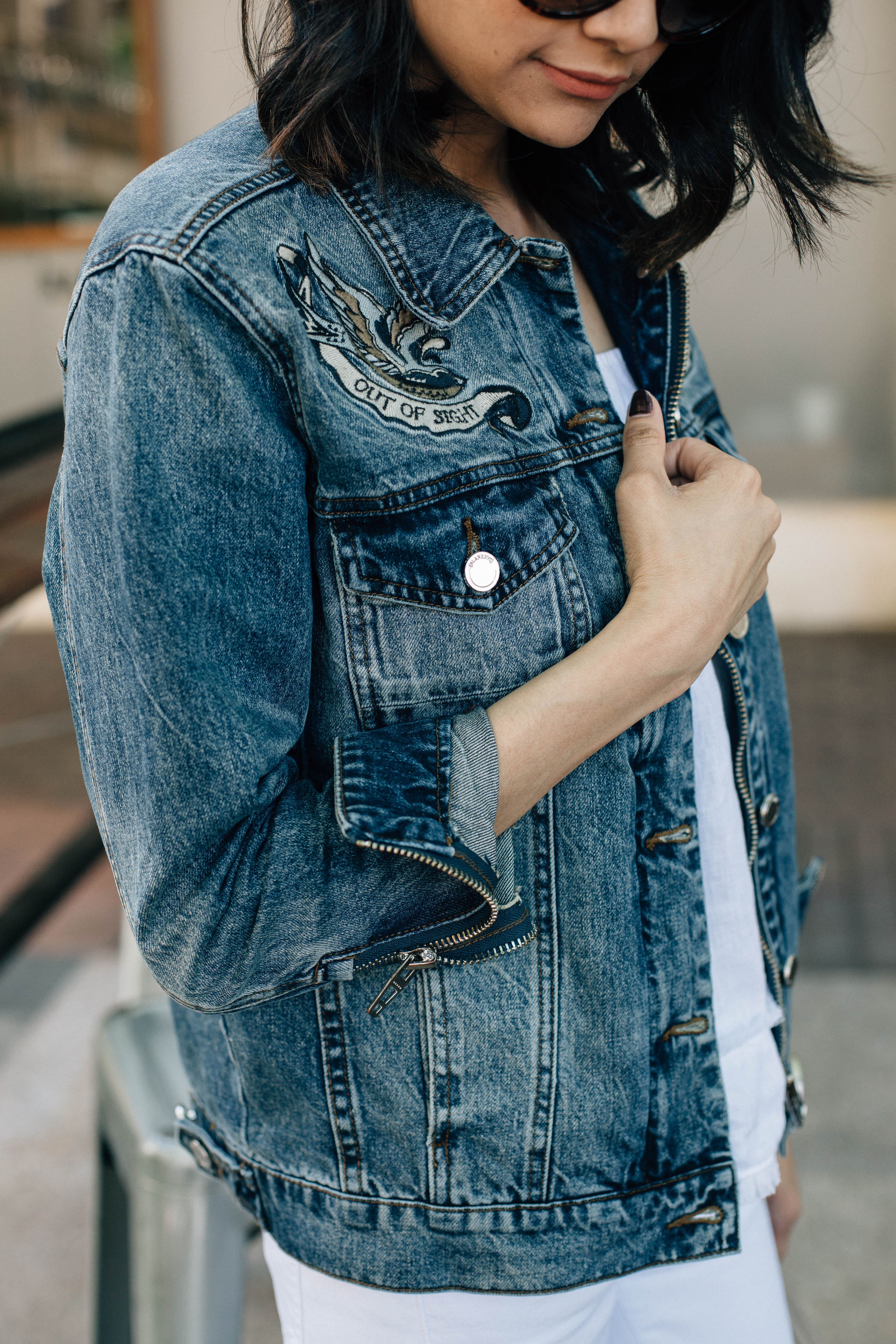Lifestyle blogger Lilly Beltran from Daily Craving wearing an ILY Couture embroidered denim jacket