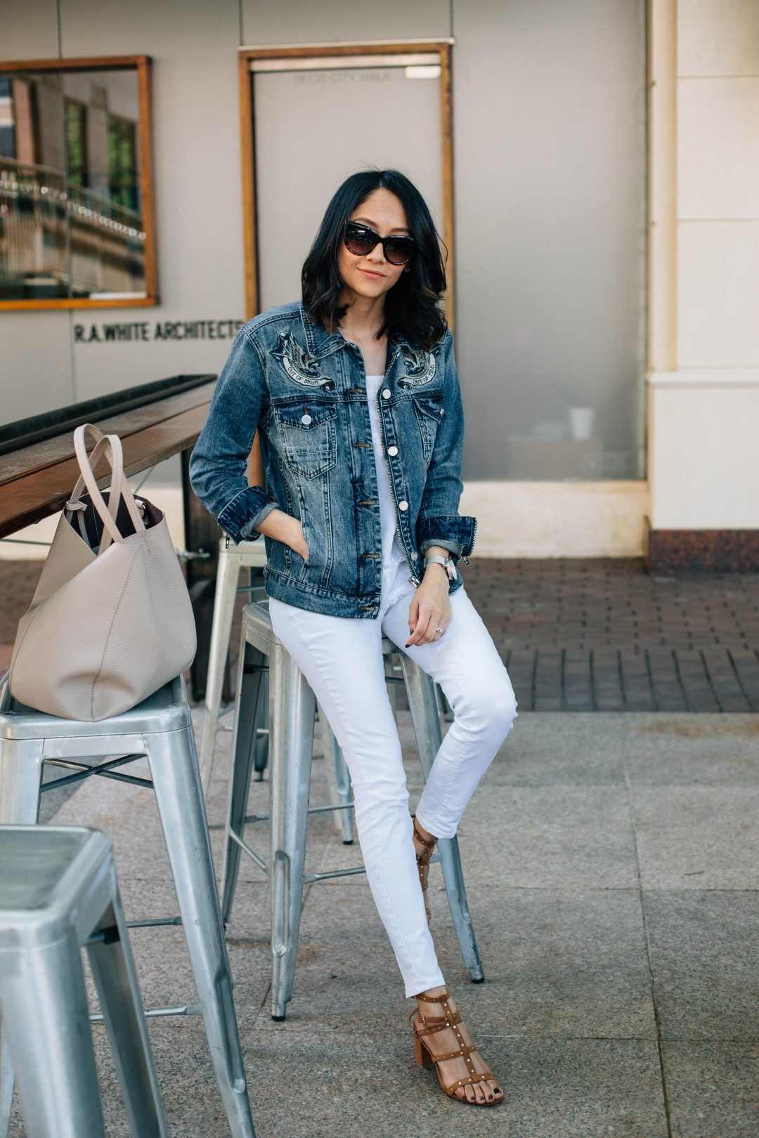 Lilly Beltran of Daily Craving blog in a casual weekend look with white denim pants and blue denim jacket