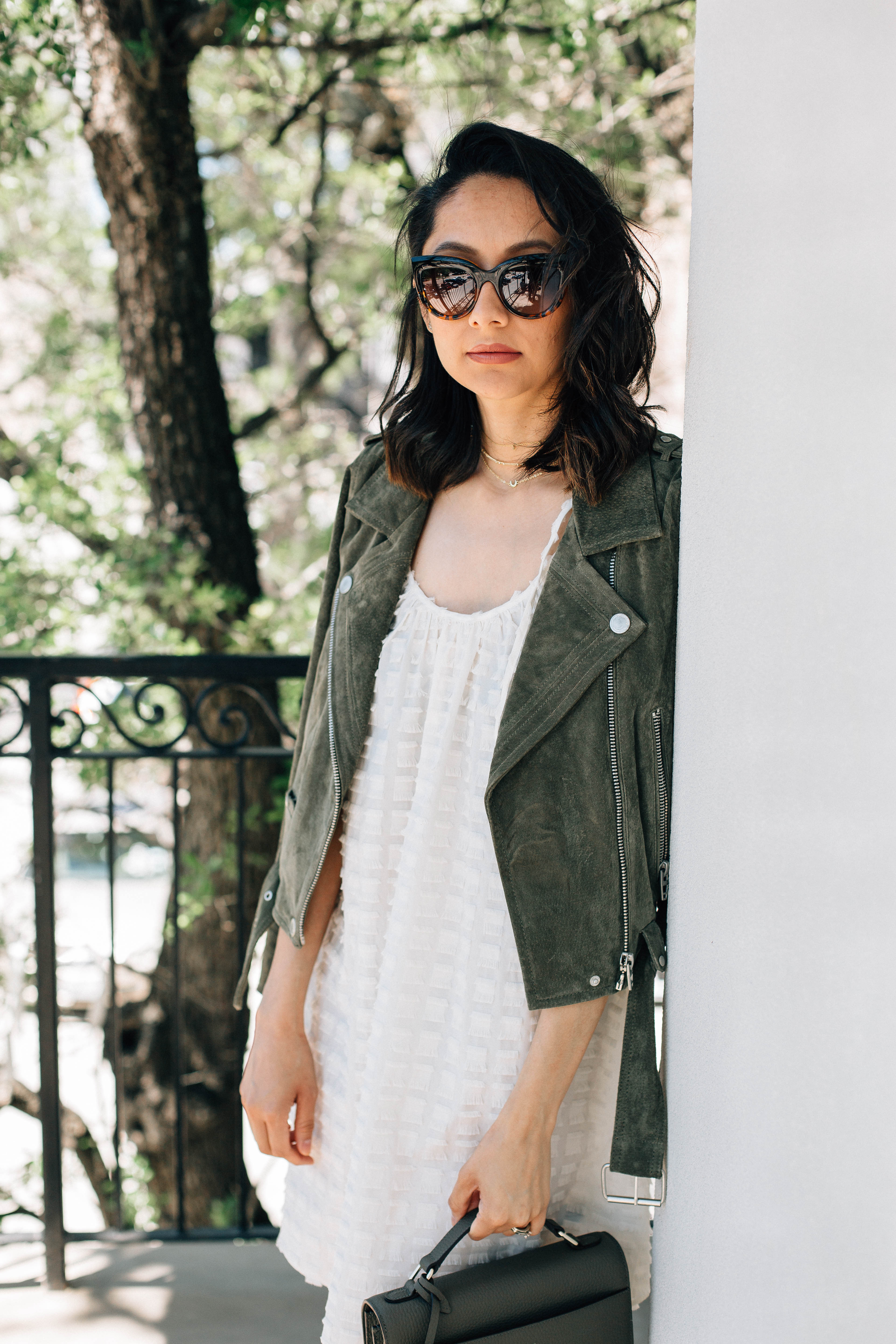 Lifestyle blogger Lilly Beltran of Daily Craving wearing a suede Moto jacket
