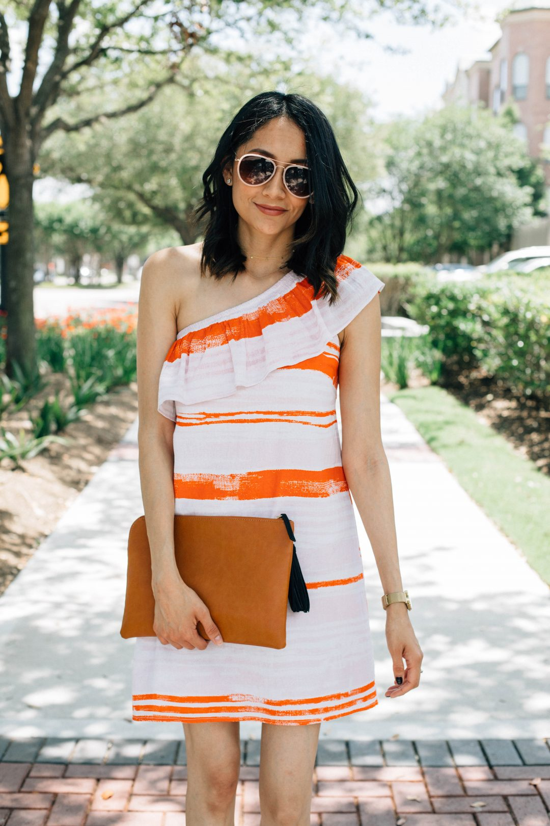 Lilly Beltran of Daily Craving blog wearing a one shoulder striped dress