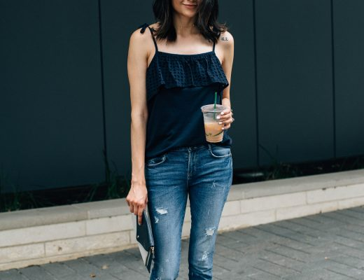 Lifestyle blogger Lilly Beltran of Daily Craving in a casual look wearing a navy eyelet top