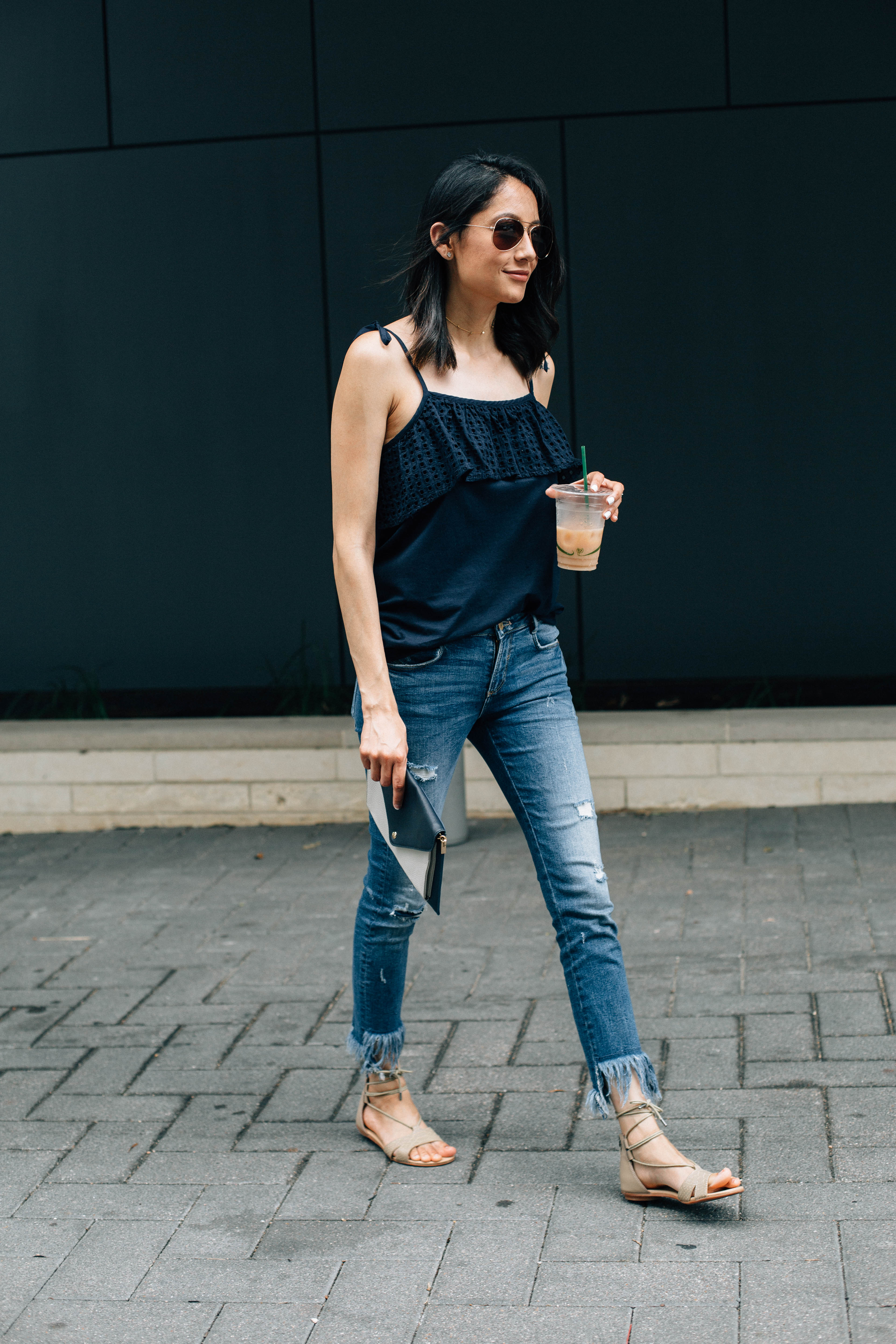 Lifestyle blogger Lilly Beltran from Daily Craving wearing a denim jeans and nude lace up sandals